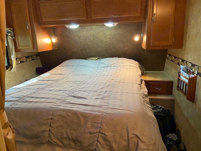 "Very comfortable queen bedroom with 4"" Memory Foam mattress. Black out blinds help during summer nights.. Lance 2285 2011"