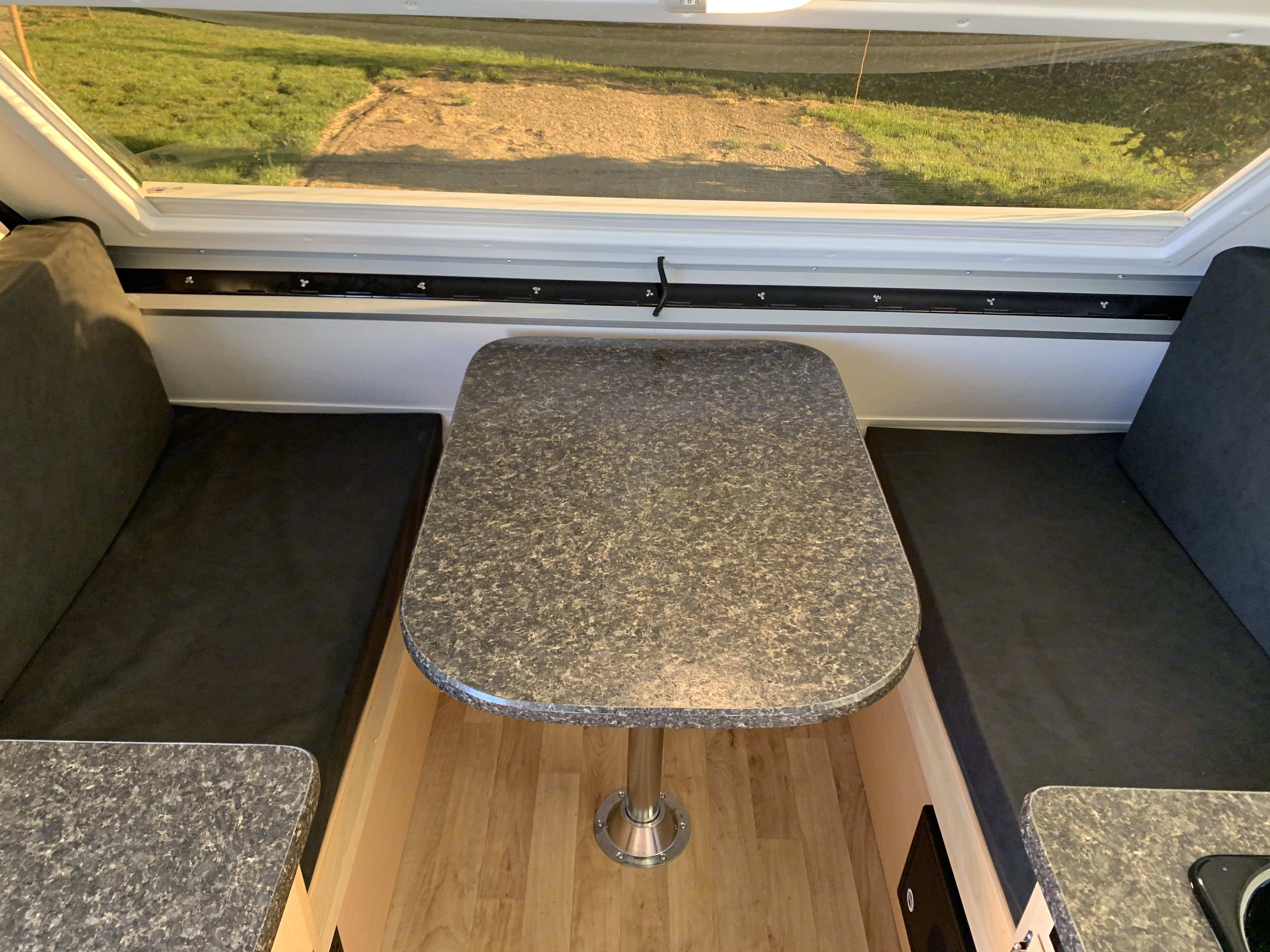 Dining area converts to bed!. A-Liner Scout 2019