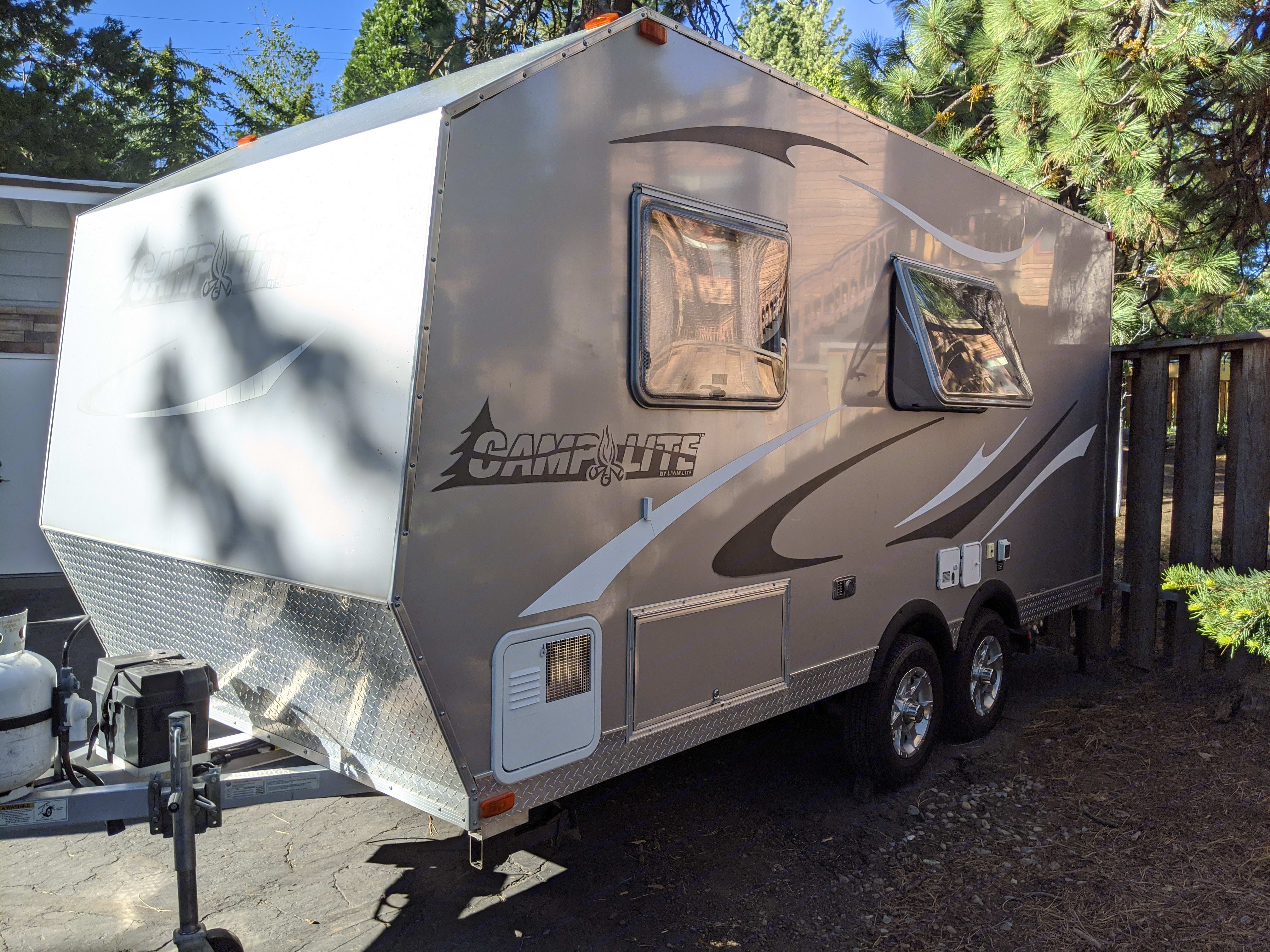 Front/side view with storage accessible from outside or inside the trailer. Livin' Lite Camplite 2012