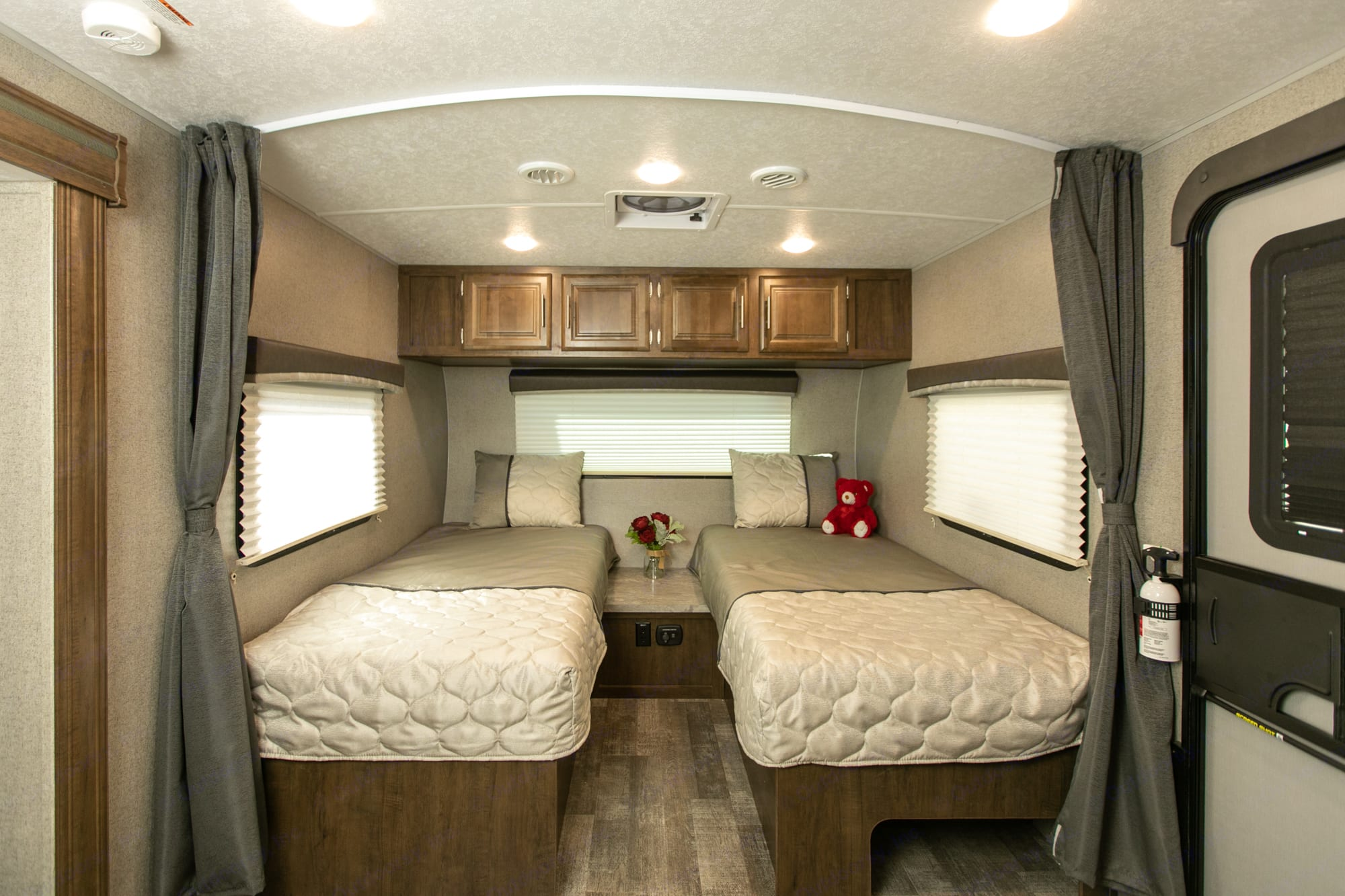 Two twin beds with heated mattresses. Forest River Rockwood Mini Lite 2020