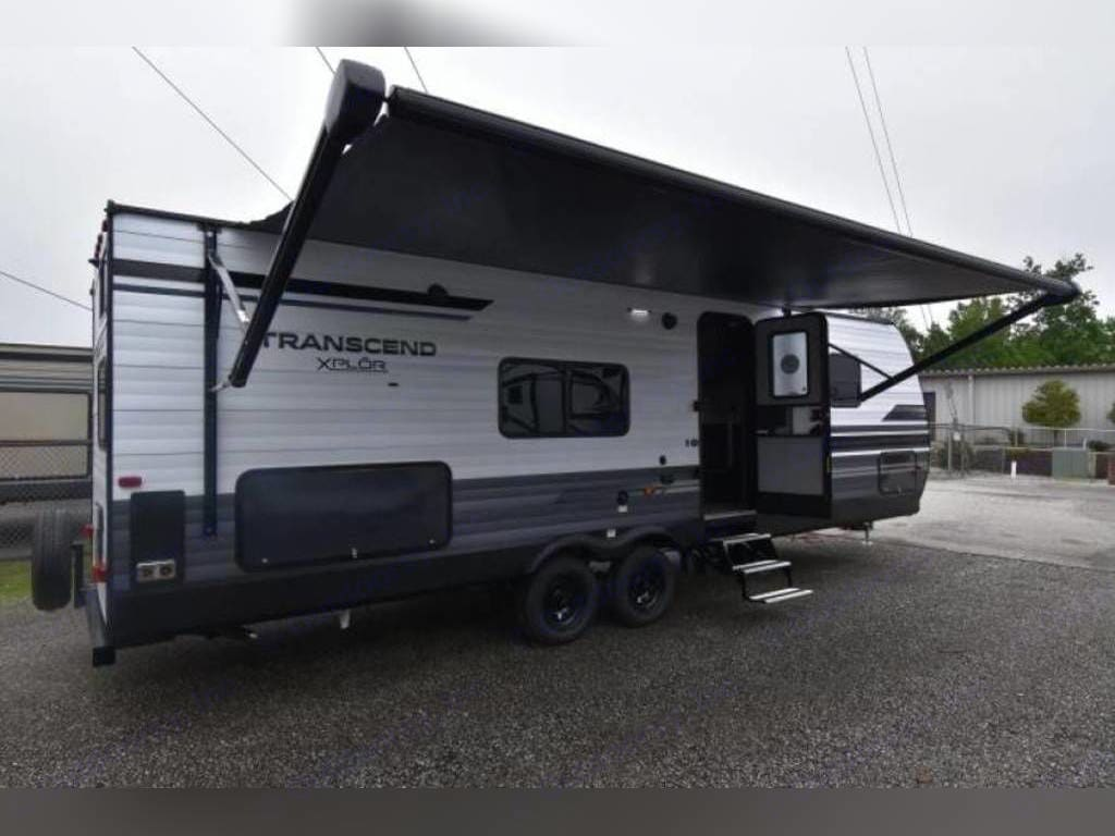 Side view with awning extended. Grand Design Transcend 2020
