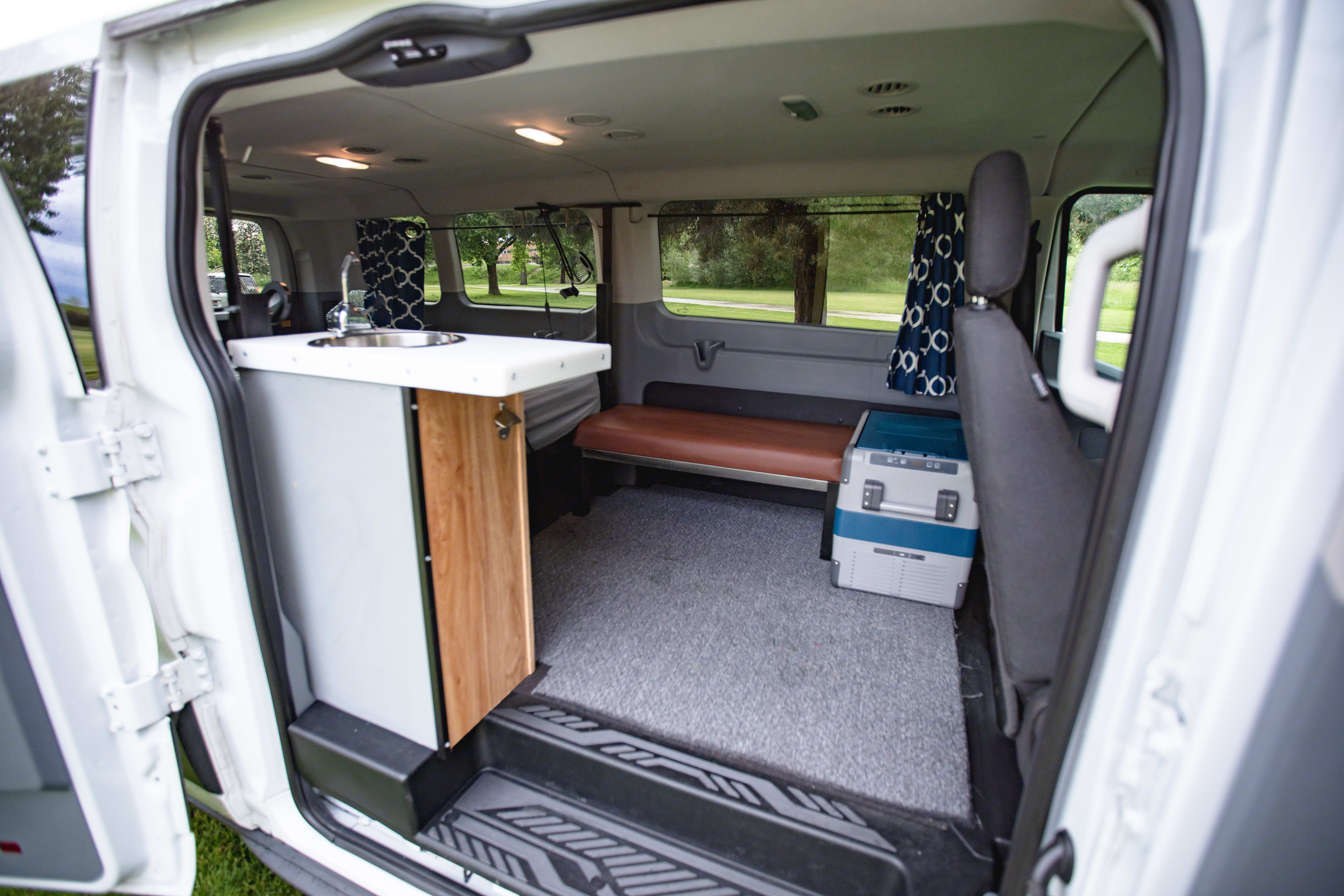 A hand pump sink, fridge and gas powered stove for your cooking needs. . Ford Transit 2019