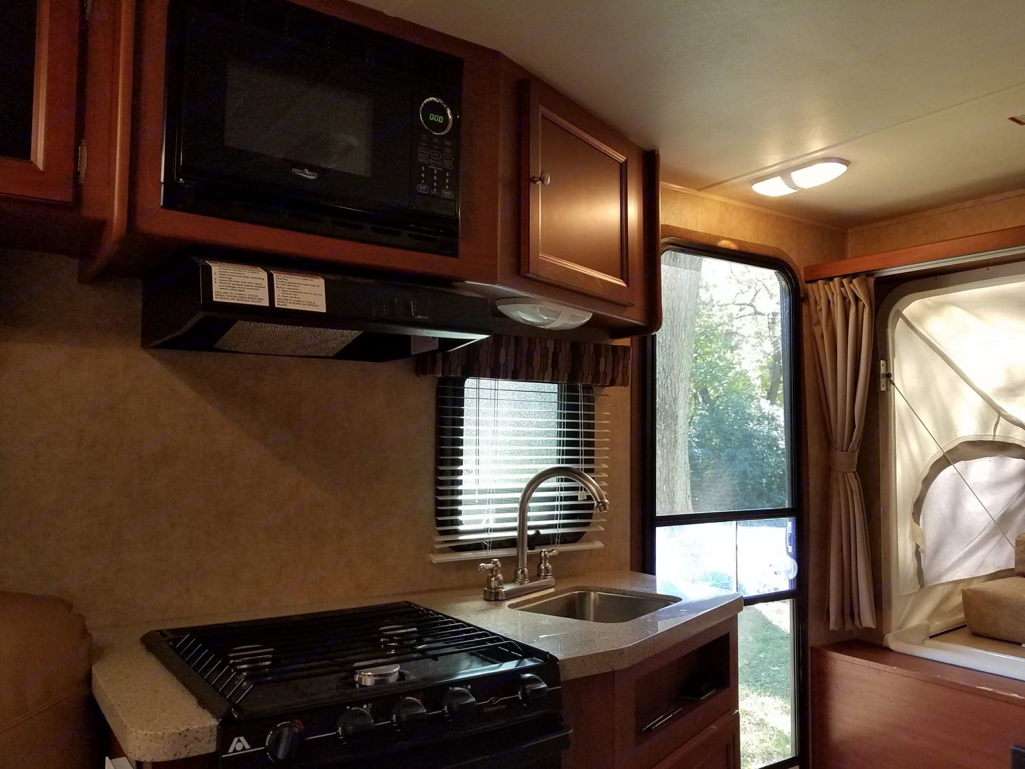 Stove, microwave and sink. Coleman Dutchman 2012