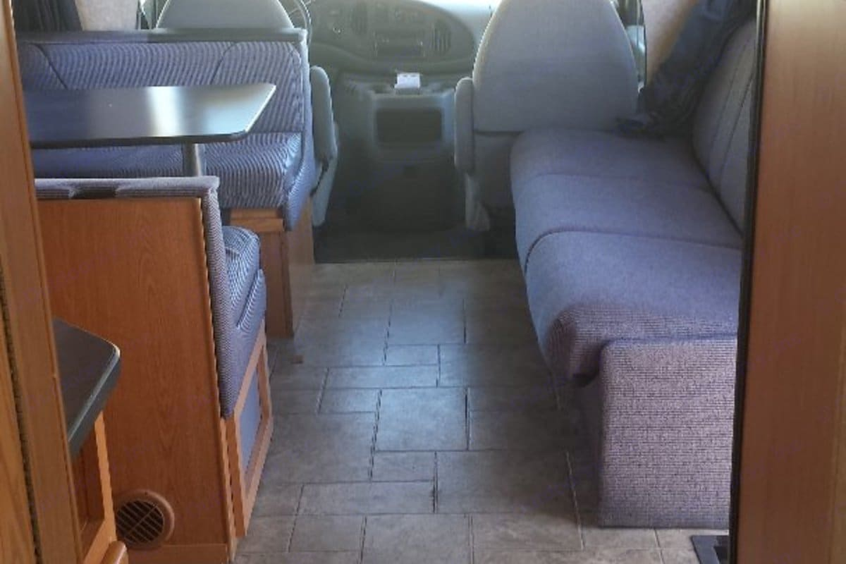 Looking forward at dinette, futon style sofa bed and cab. Thor Motor Coach Four Winds Majestic 2009