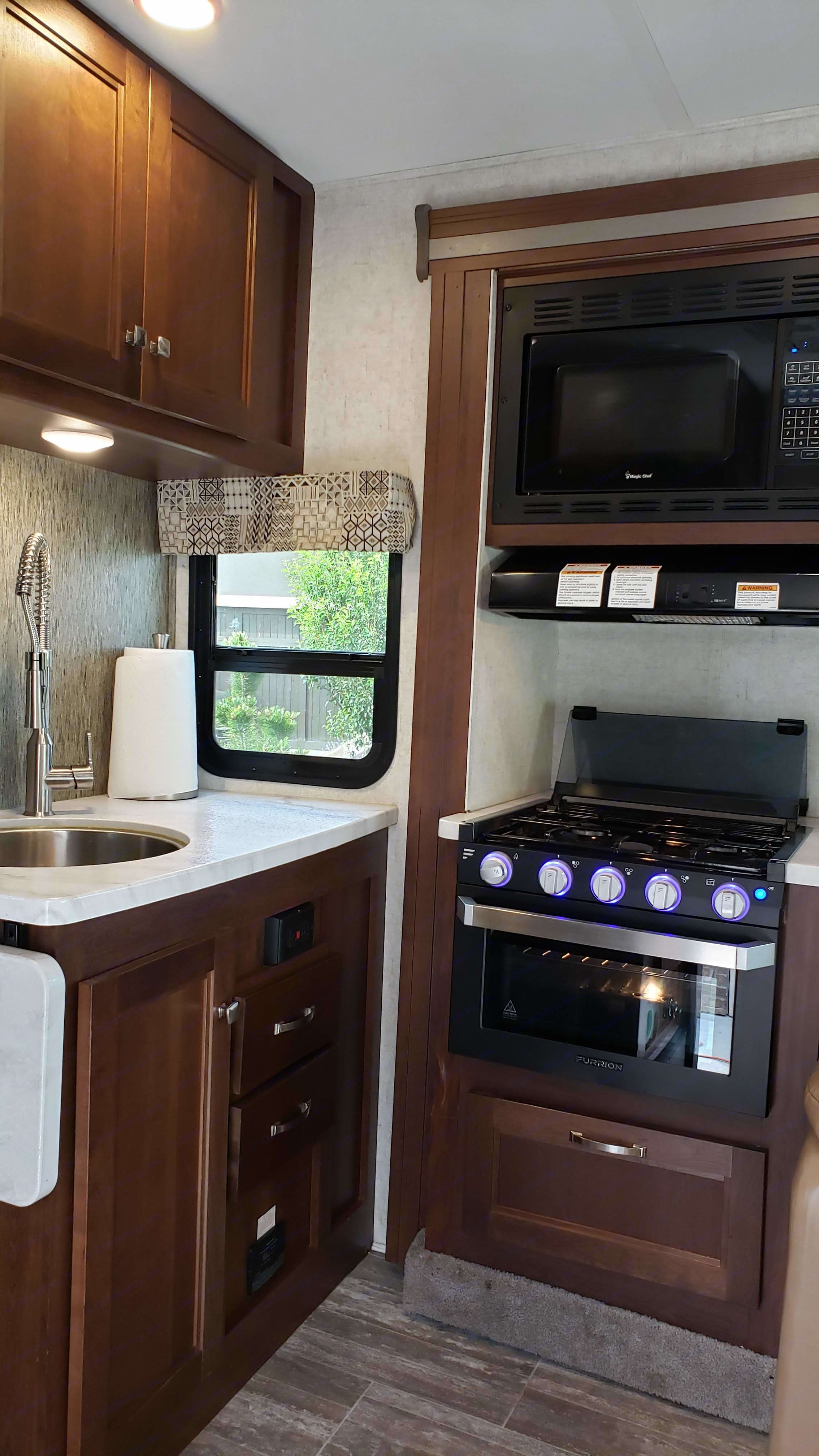 Kitchen with Stove, Oven, and Microwave. Forest River Sunseeker 2019