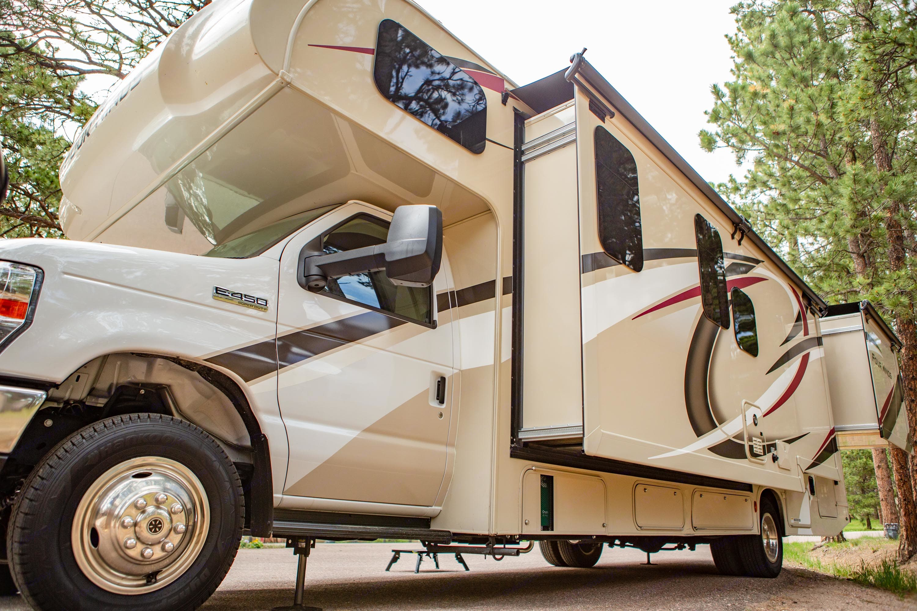With two slide-outs, the RV comfortably sleeps six and has three beds, including two queens. Thor Motor Coach Four Winds 2020