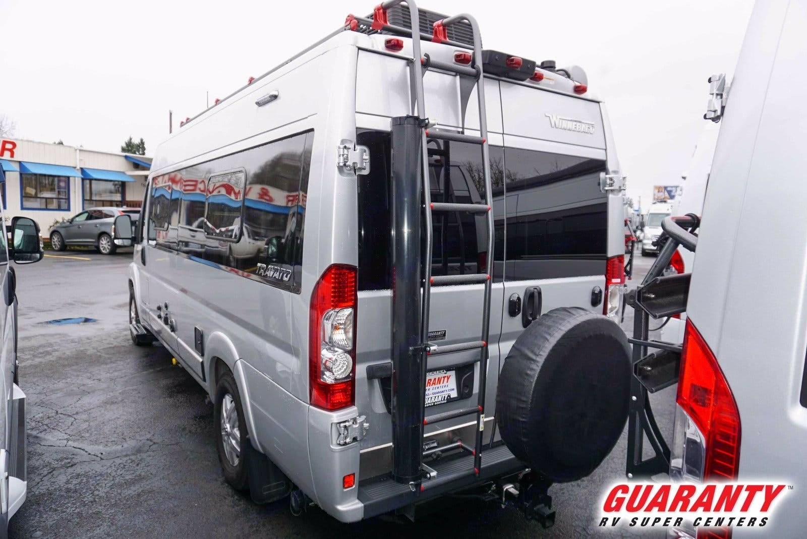 The back doors open to give you full access to that garage storage space under the bed and an outdoor shower with hot water.. Winnebago Travato 2019