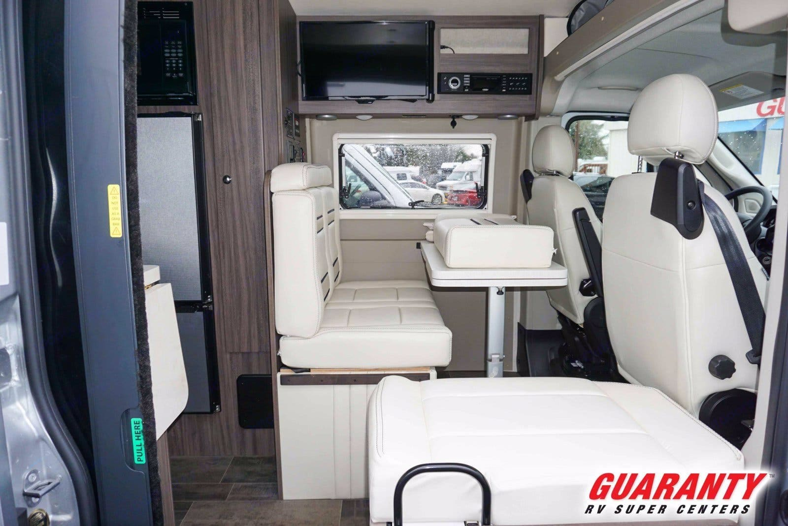 Comfortable dinette with extendable table converts to a 42x72 flat bed for the evening.  Front seats will swivel around to access dining.. Winnebago Travato 2019
