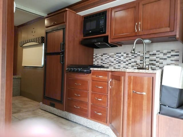easy pass thru even with slide in full walk to both sides of the bed and bathroom. Fleetwood Flair 2016