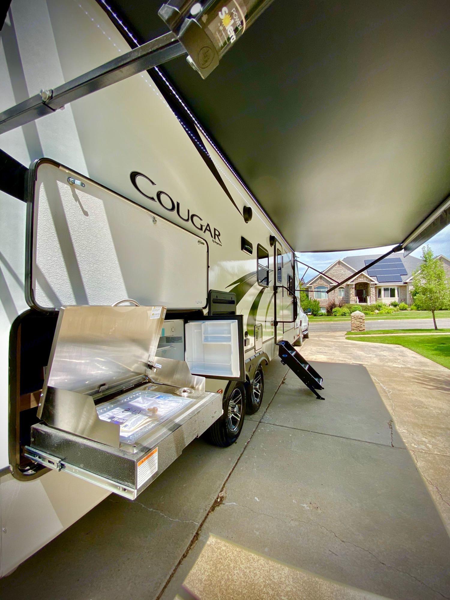 Outside grill and electric mini fridge. Keystone CougarHalf-Ton 2020
