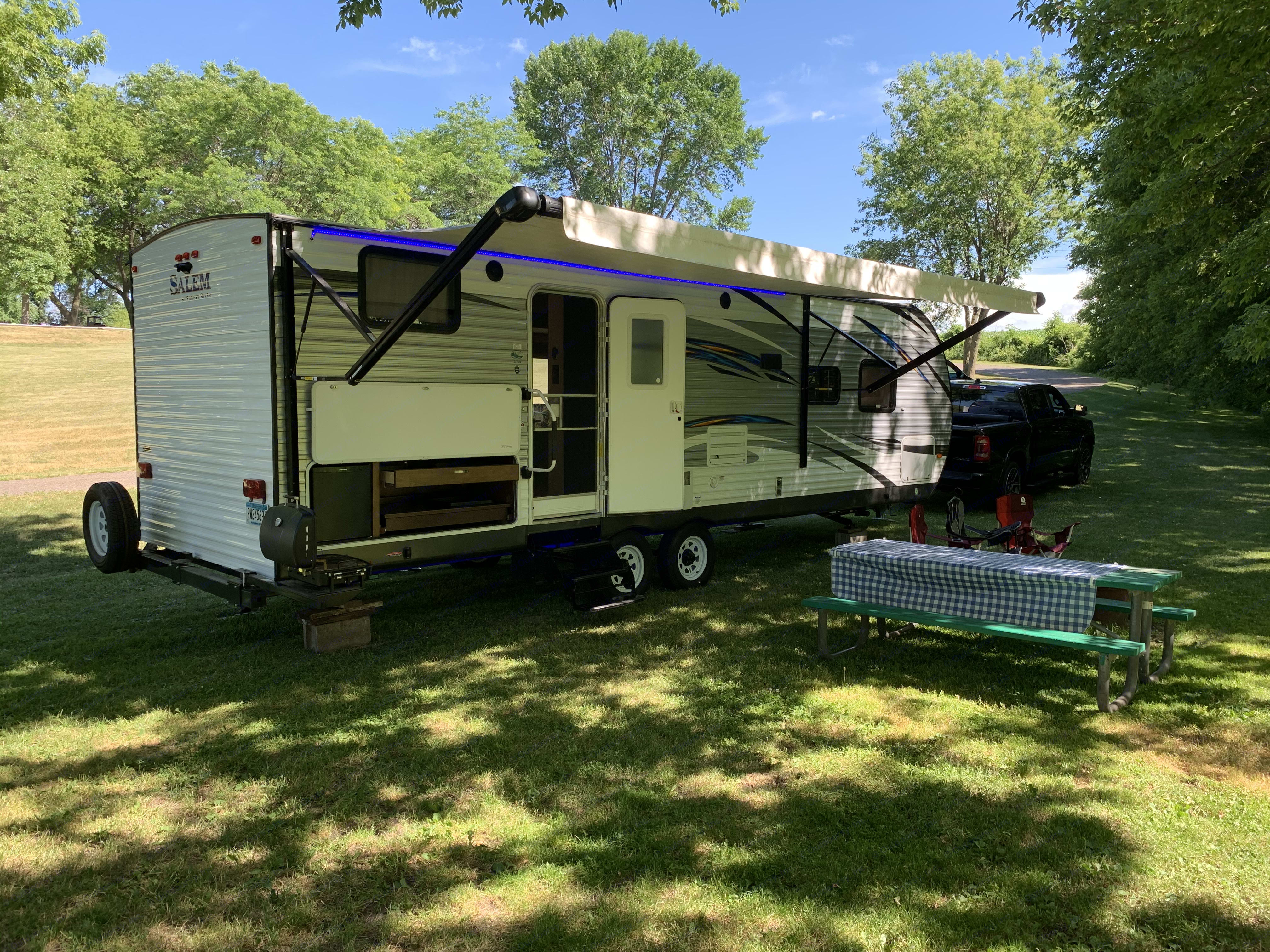 side view with power awning and outdoor kitchen. Forest River Salem 2017