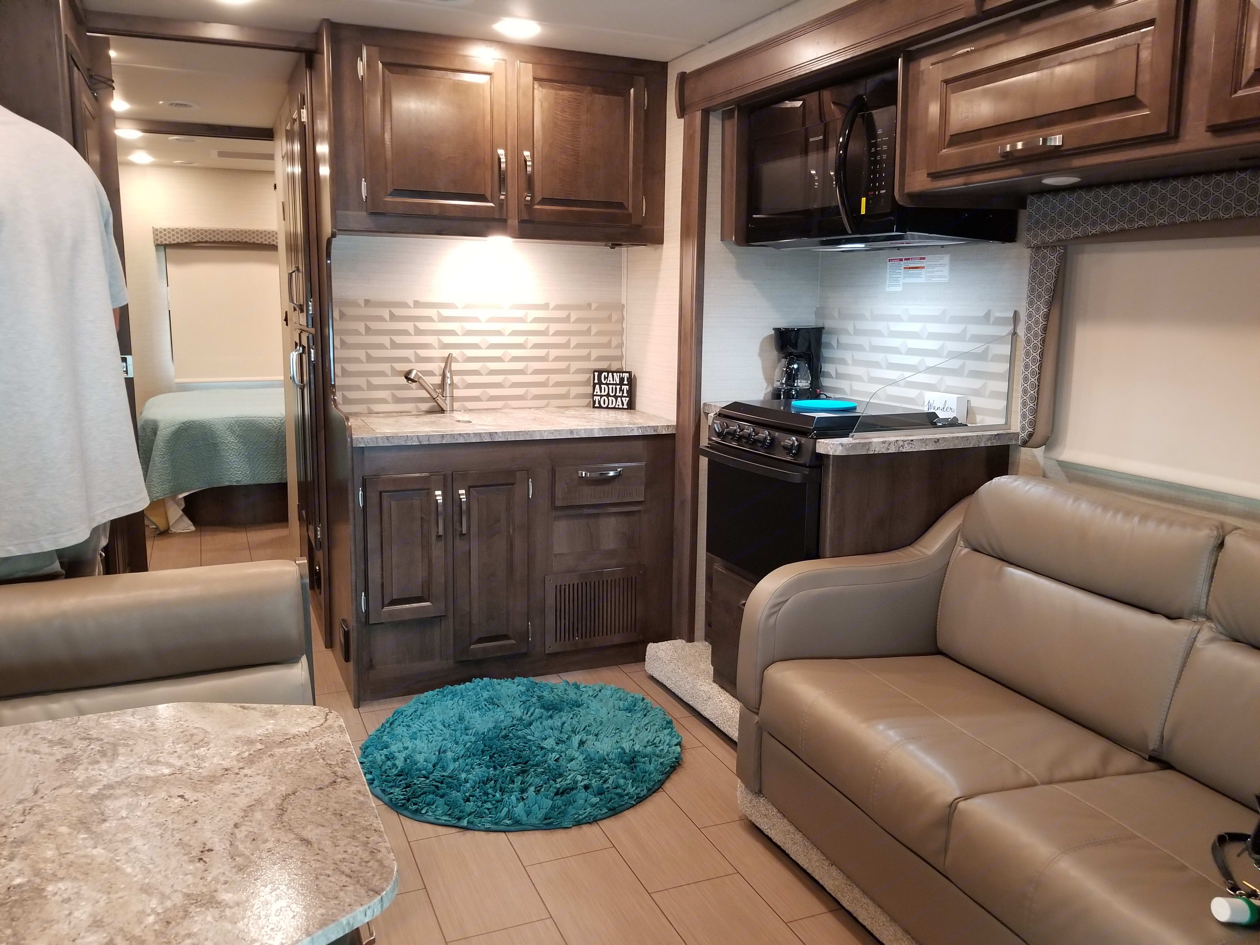 Kitchen has microwave, Stove, Oven, mixing bowls utensils, silverware,Plates, bowls and cups. Also a toaster and a Coffee maker with filters.. Jayco Greyhawk 2018
