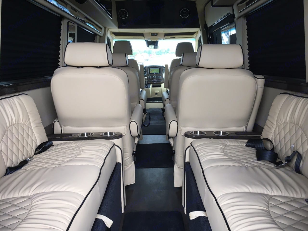 Plush sofas with seatbelts for 4 that convert into a bed. American Coach Patriot Cruiser 2019