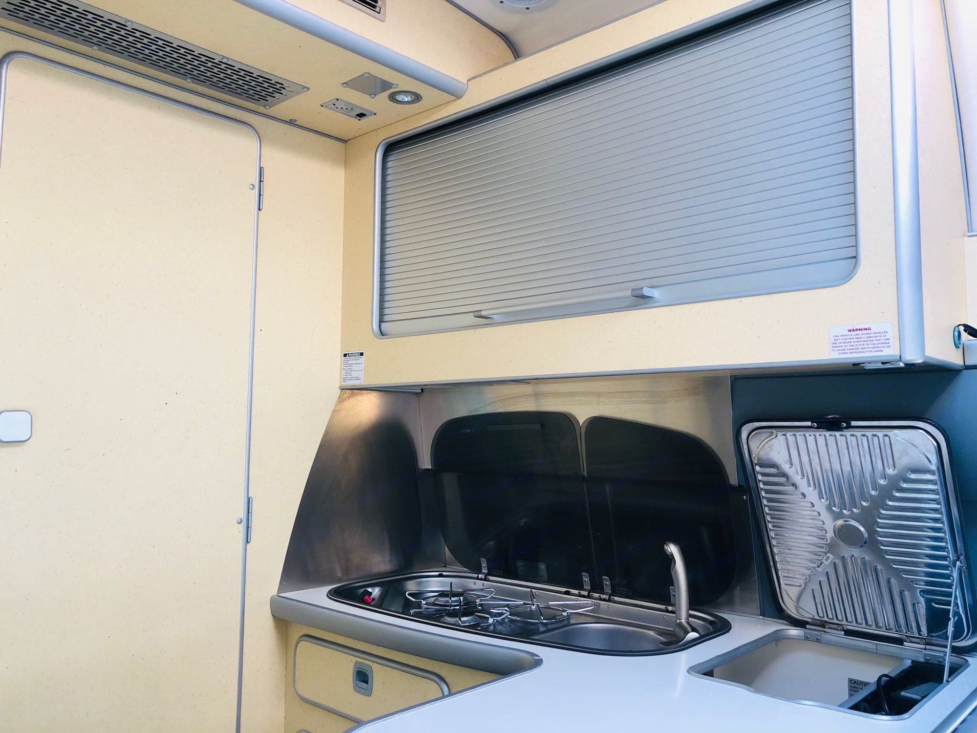 KITCHEN two single burner sink and big storage on top and 4 storage in the buttom. Airstream Sprinter 2005