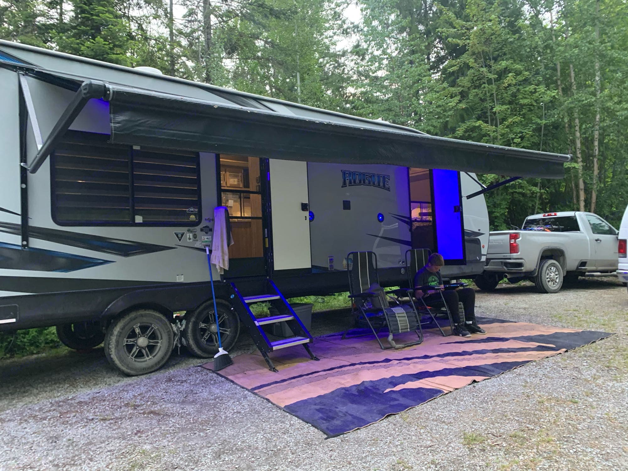 Wide awning for shade or rain. Forest River Raptor 2020