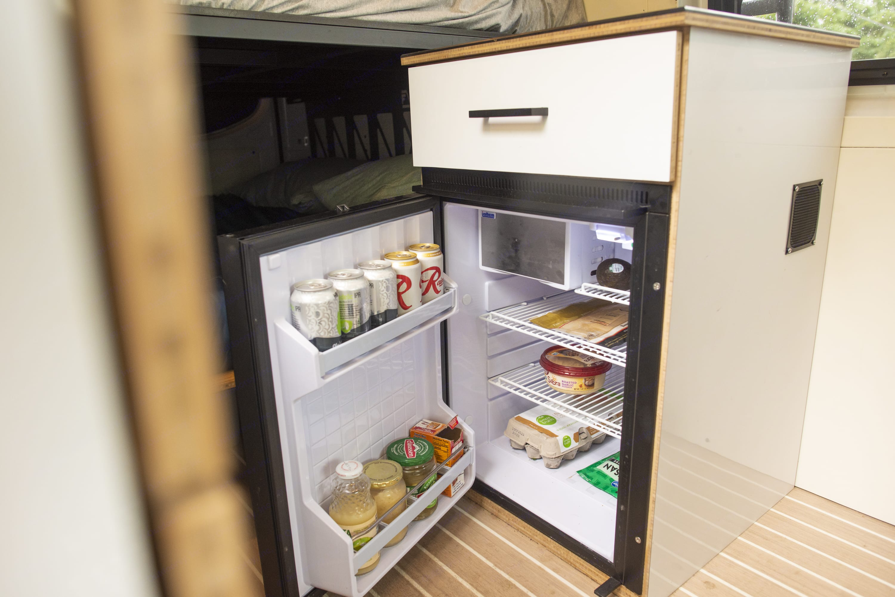 Keep your food (& beer) cold in our refrigerator.. Mercedes-Benz Sprinter 2019