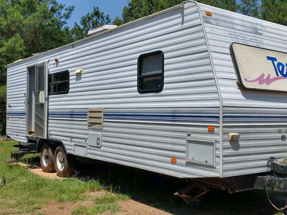 Outside Side view  also has pull down steps. Terry 30g 1998