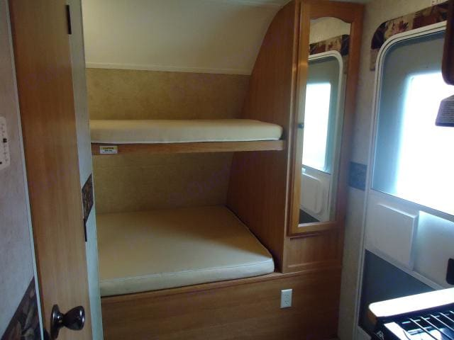 Bunk beds and closet storage. Keystone Passport 2008