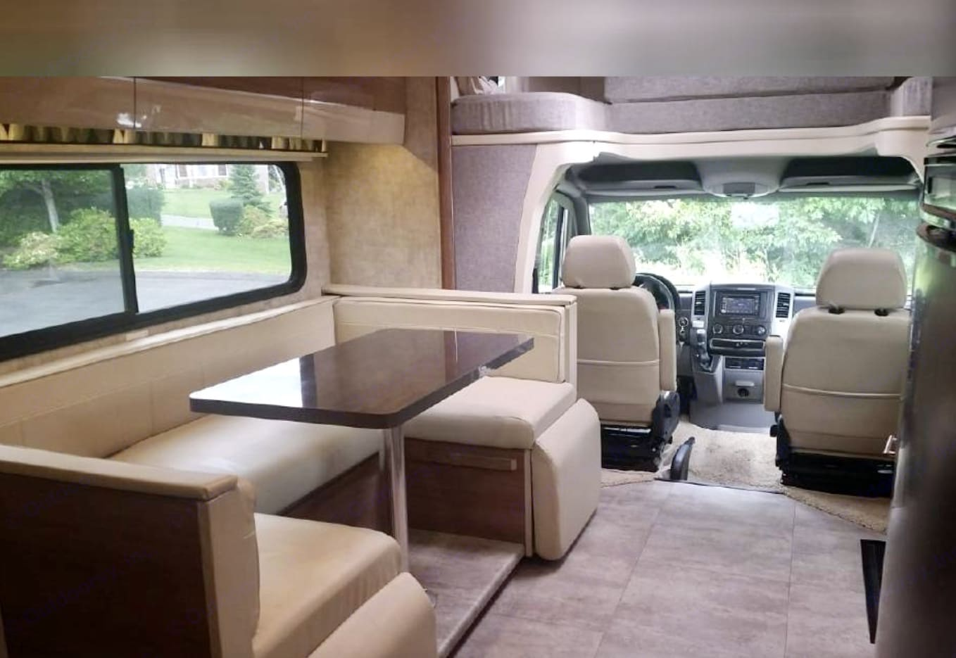 U-shaped dinette seats 5, captain chairs swivel as well for additional seating. Winnebago Navion 2015