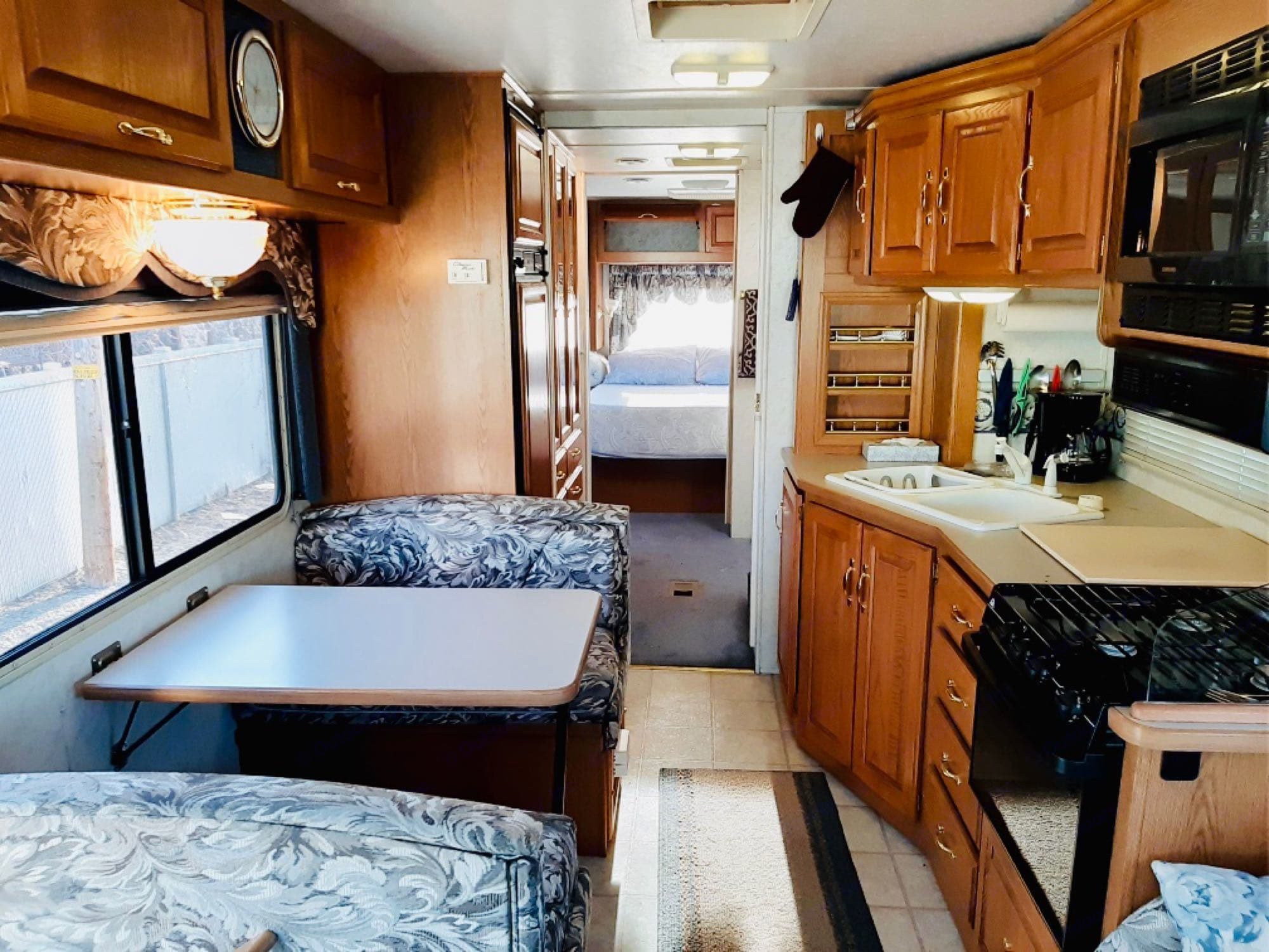 while the slide out is still in, you have a good amount of space to entertain and spend time with family. It's clean and very comfortable. For sleeping the table converts into a full size bed. Propane stove is easy to use and you'll have all the equipment you'll need to make your favorite meals.. Thor Windsport 34k 2000