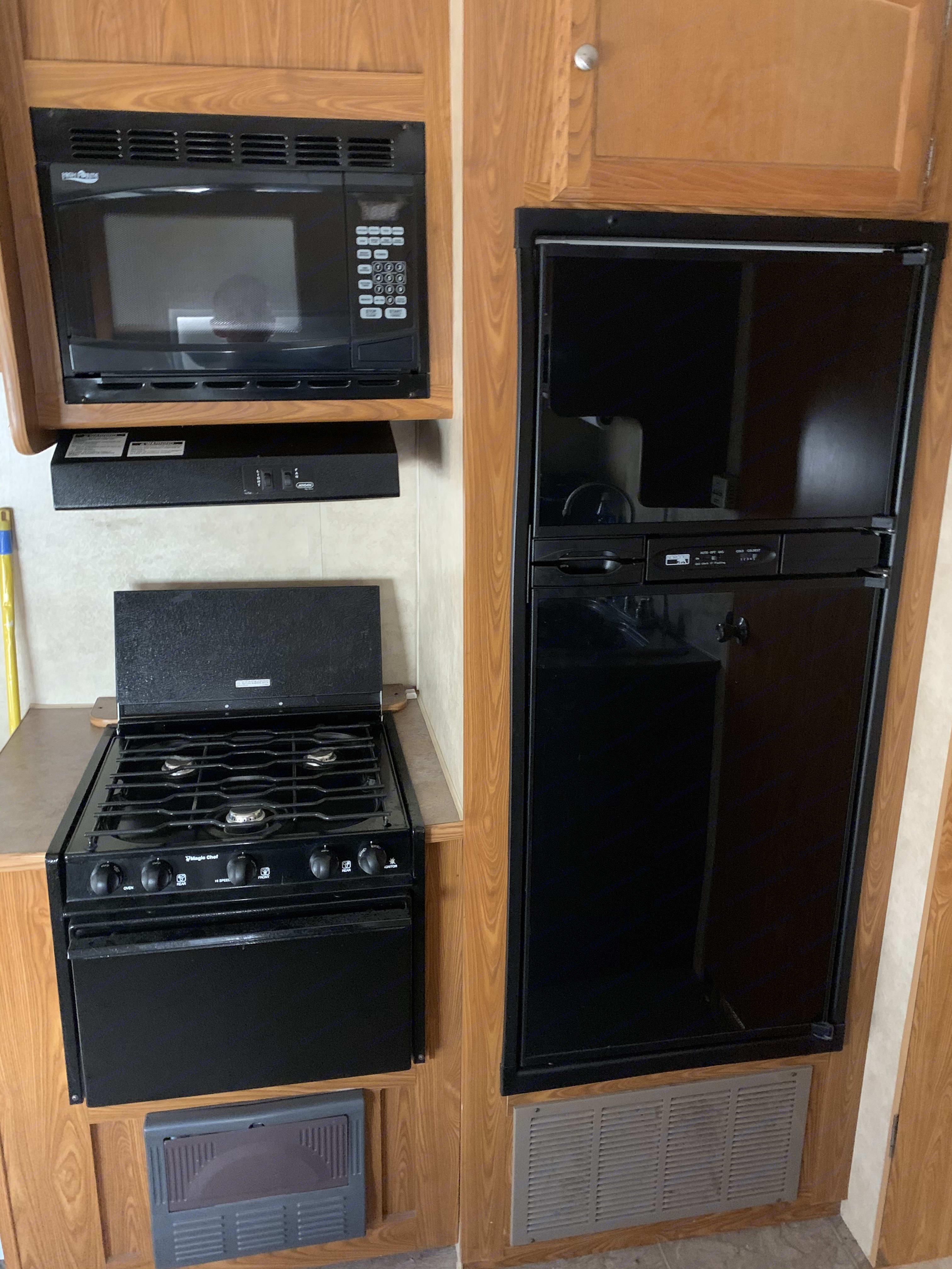 Full size fridge, range, microwave. Dutchmen Ntense 2009