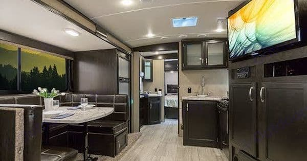 Kitchen with dinning table set up. Granddesign Imagine2500RL 2018