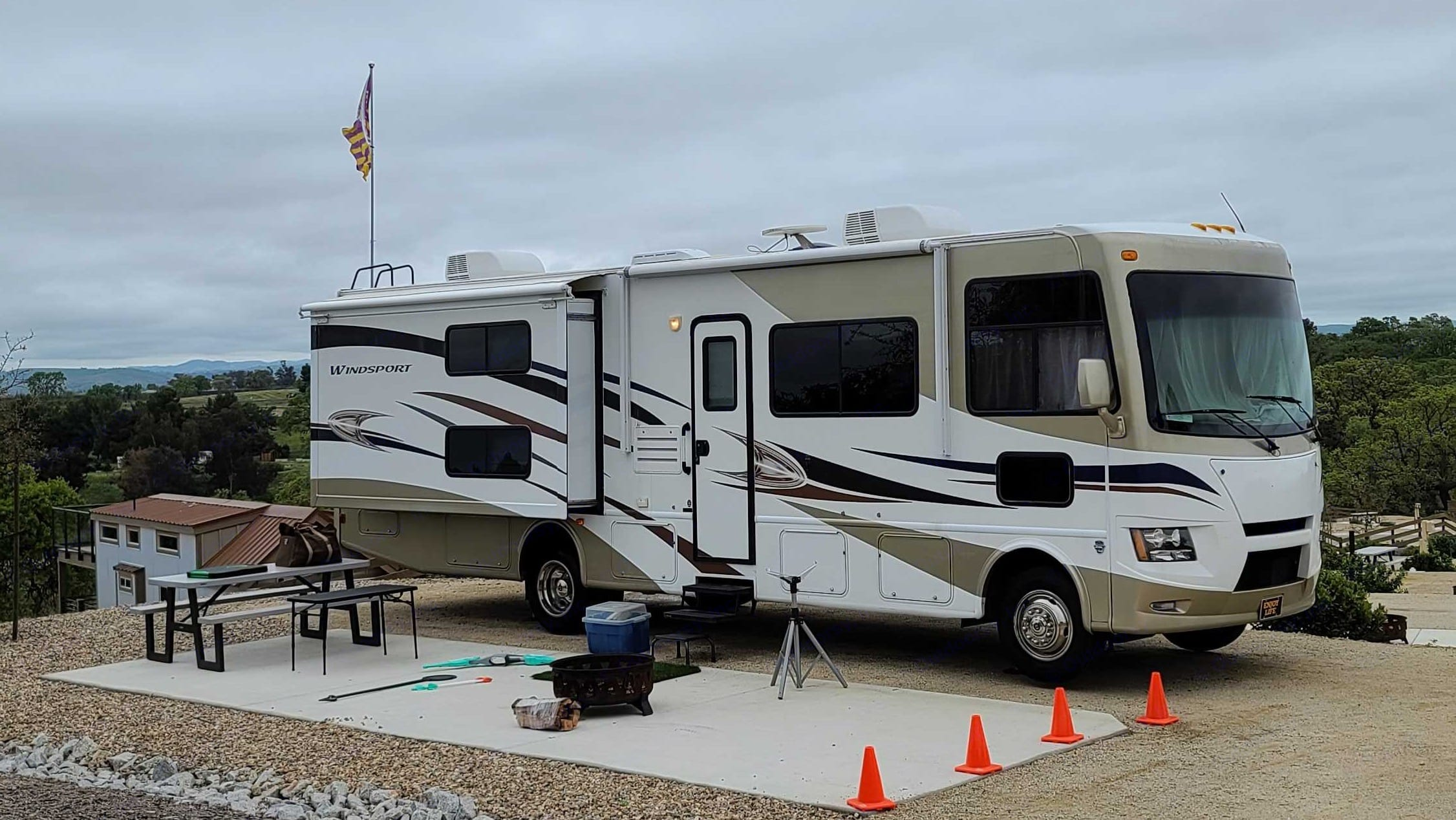 Camping with slide-out A open . Thor Motor Coach Windsport 2014