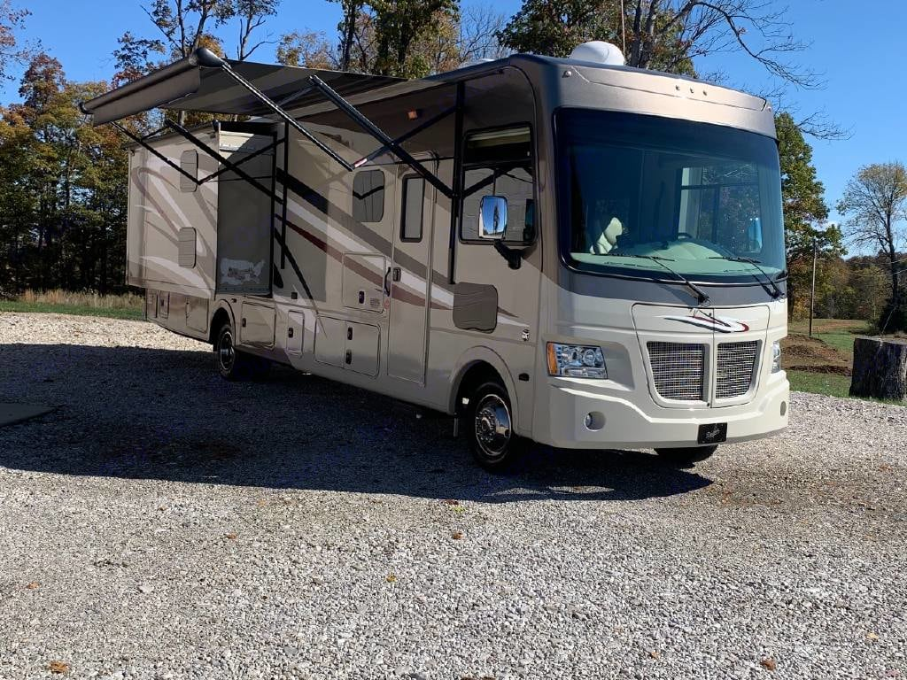 Bunk slid out and Power Awning. Coachmen Mirada A-Class 2015