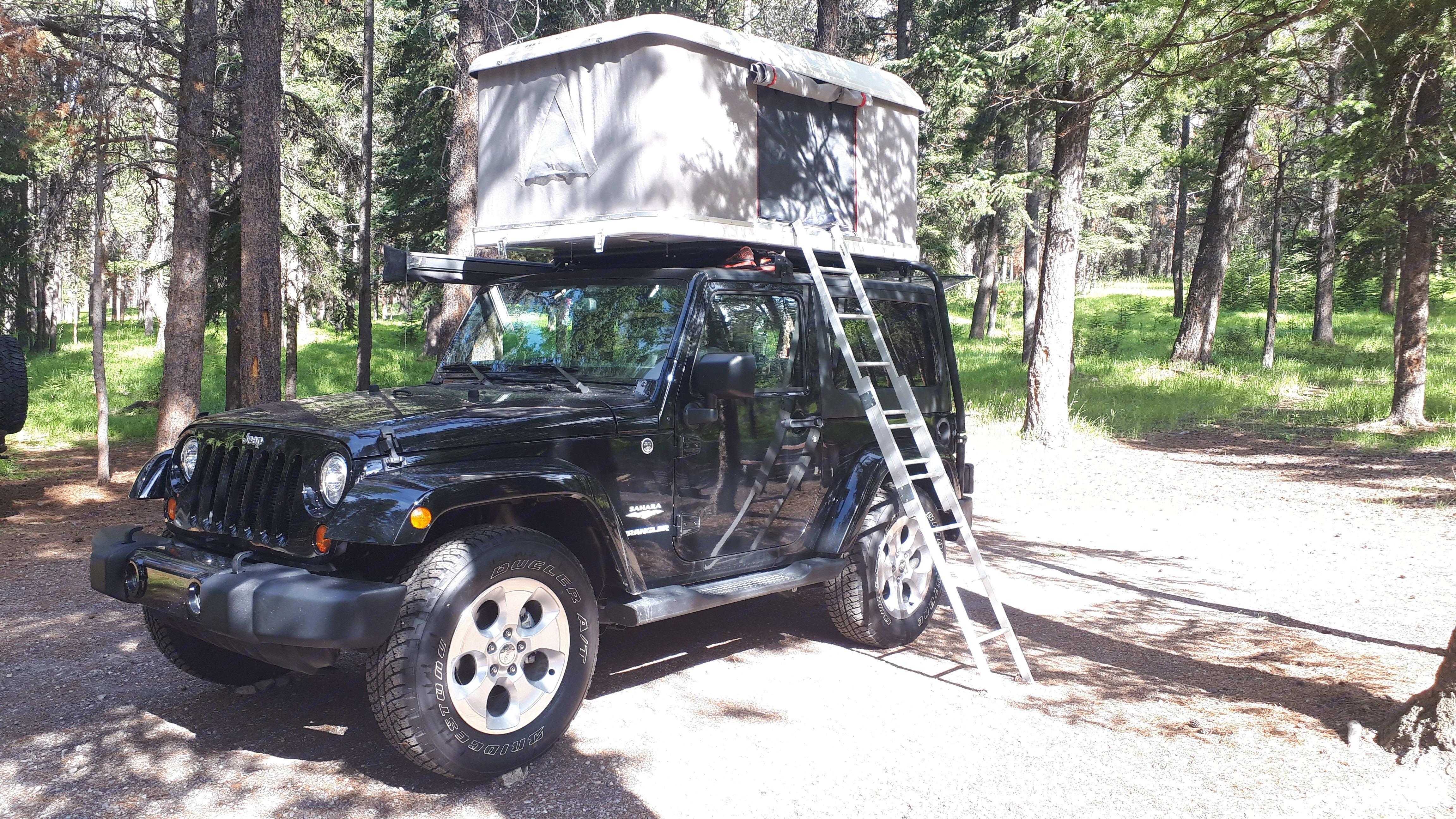 2-door Jeep JK Sahara with Autohome Roof top tent. Jeep Wrangler JK 2013