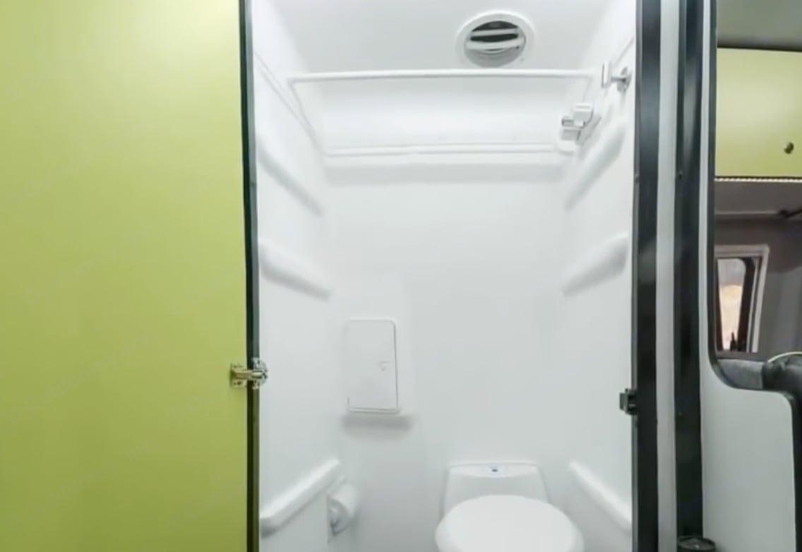 bathroom w/ shower & toilet (or storage closet w bamboo shelves). Winnebago Revel 2020