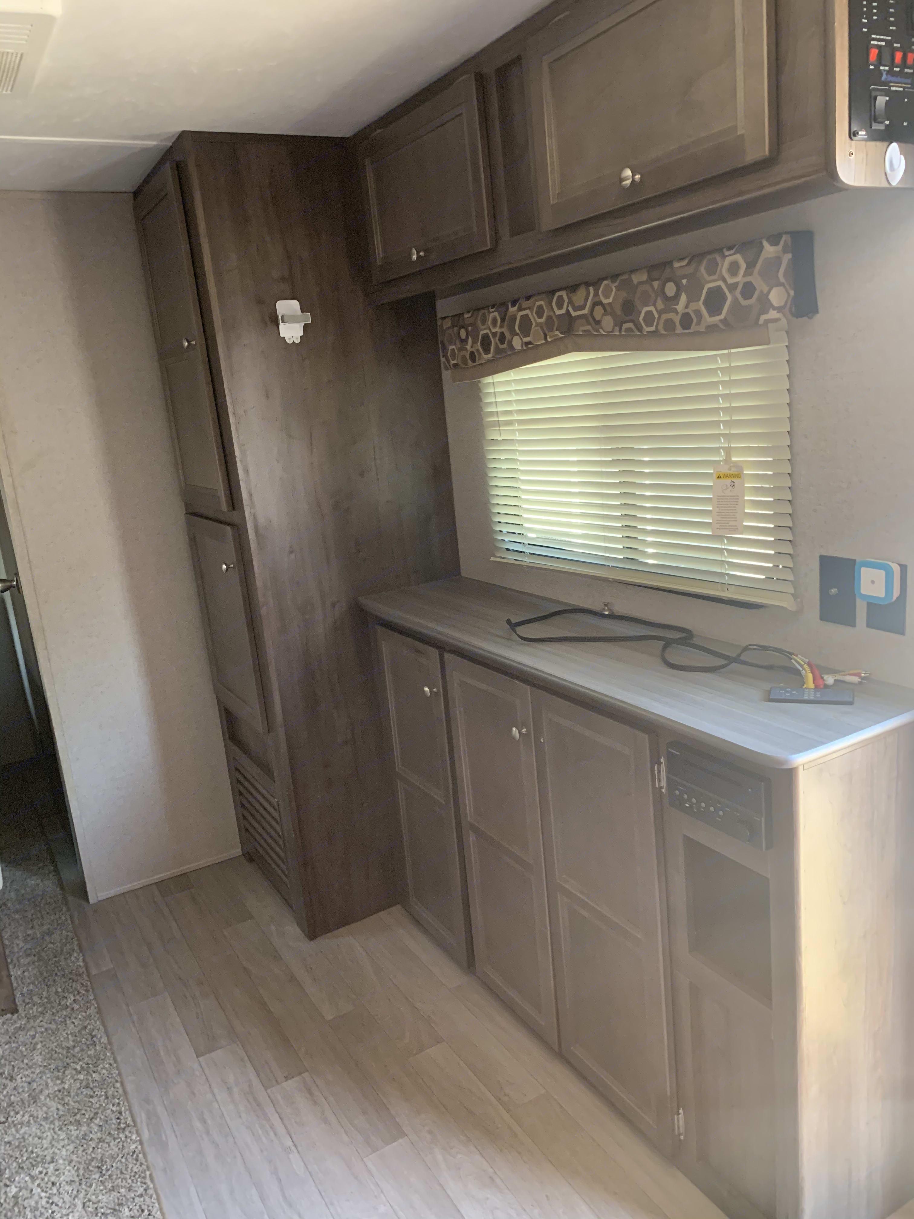 Living room storage. Dutchmen Coleman 2018