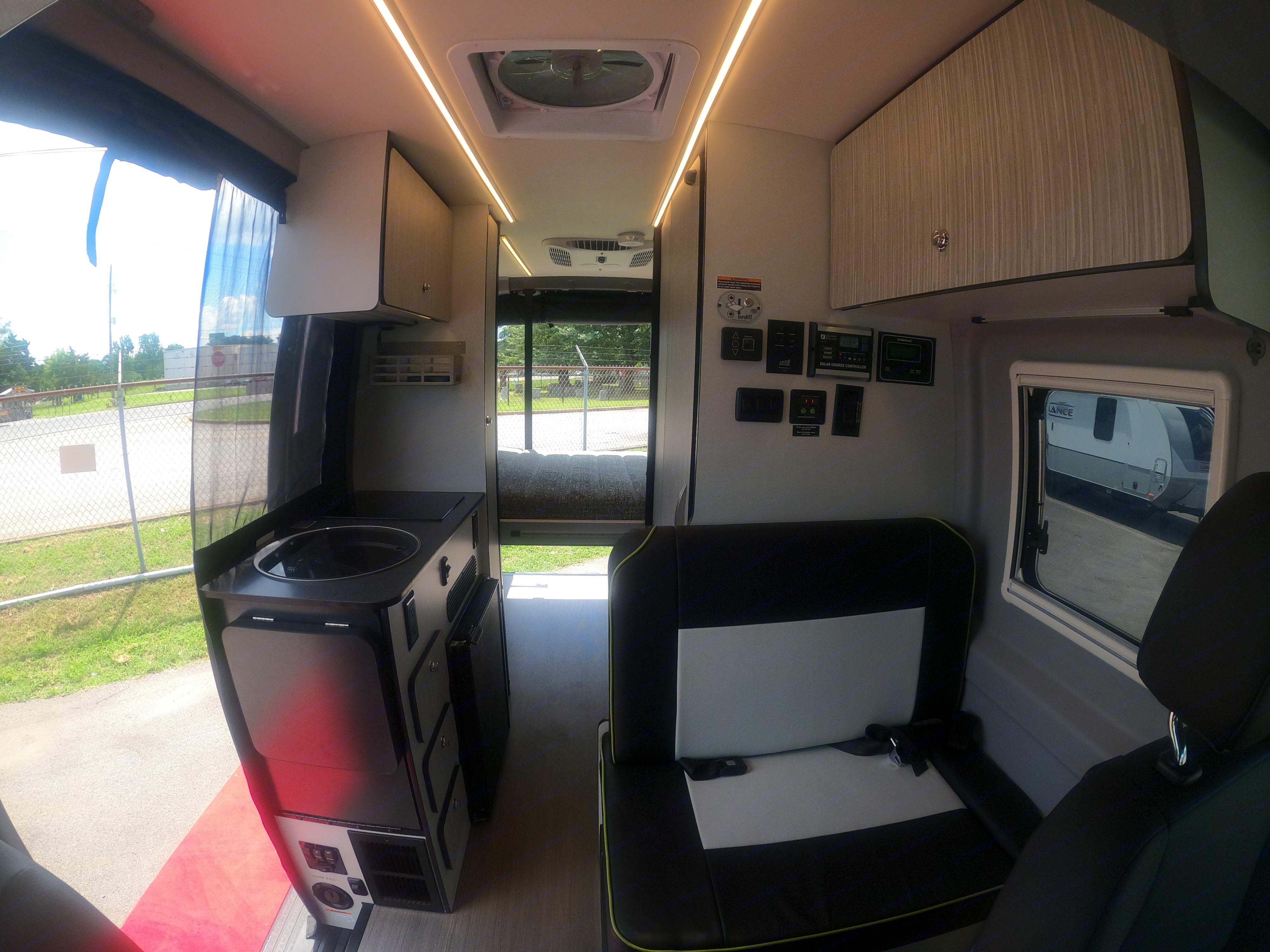 Interior View: Kitchen, Dining & Bedroom Area. Winnebago Revel 2020
