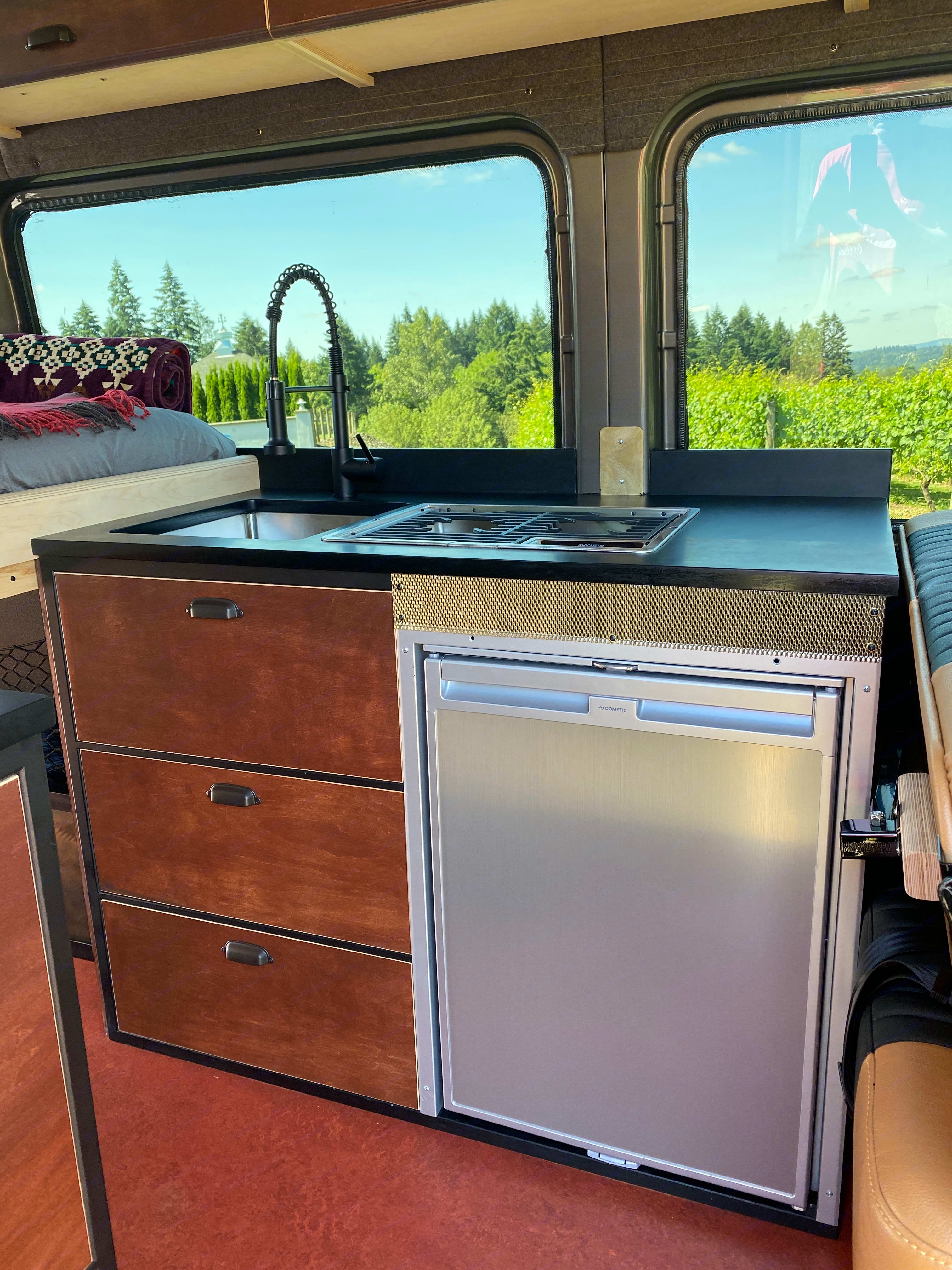 All the cabinetry, framework, counter/table tops, side walls, seating and upholstery have been designed and built by the talented VanStable crew. . Mercedes-Benz Sprinter 2019