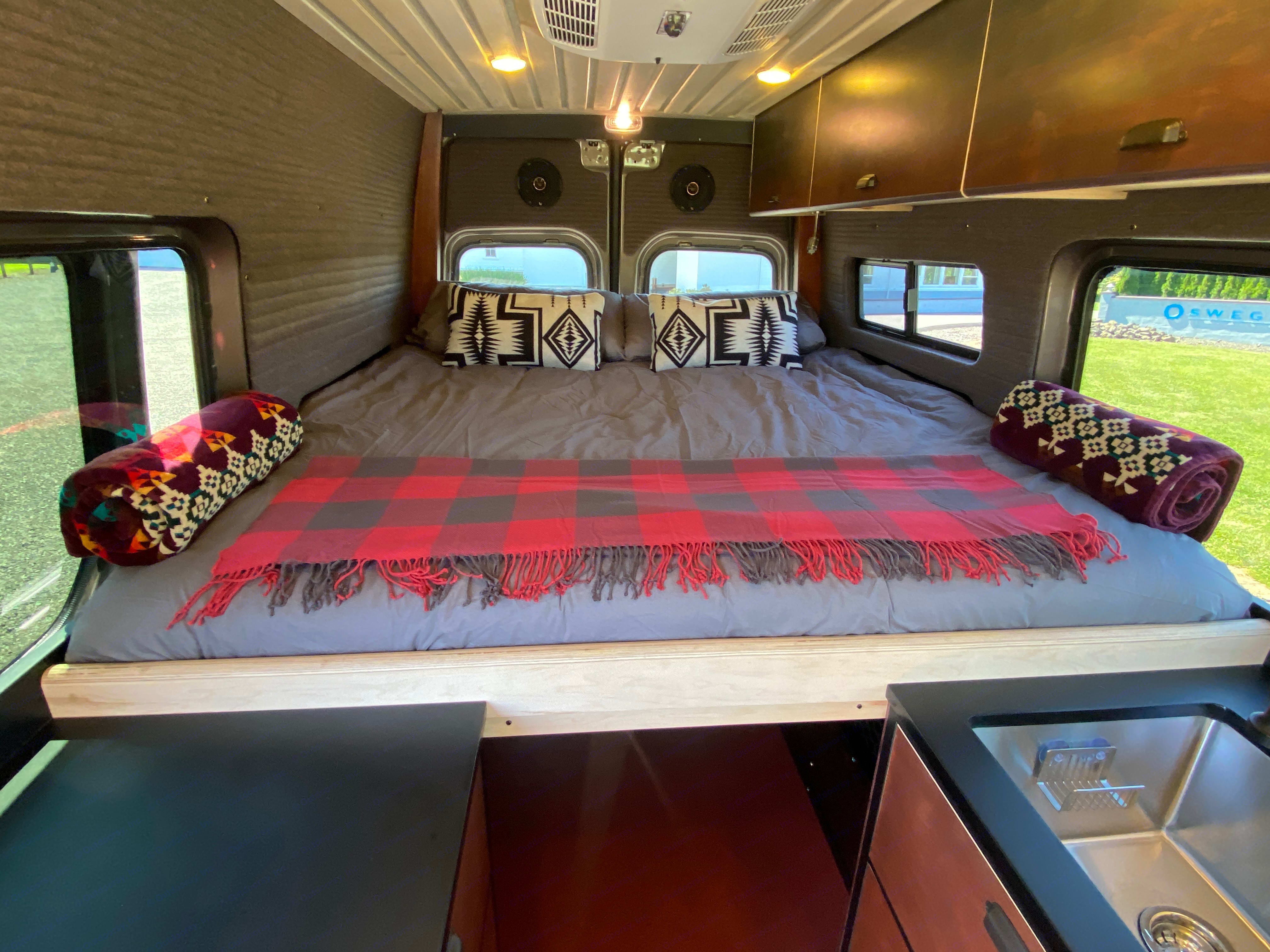 """Yes, those are Pendleton blankets and pillows on the nearly King sized platform bed with 5"""" thick memory foam mattress.. Mercedes-Benz Sprinter 2019"""