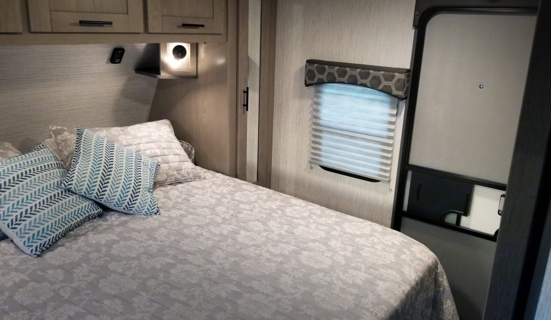 Your feet won't hang off the end of this Residential-sized Queen bed. Access on 3 sides and an Exit door so you won't wake sleeping guests.. Cruiser Rv Corp Shadow Cruiser 2020