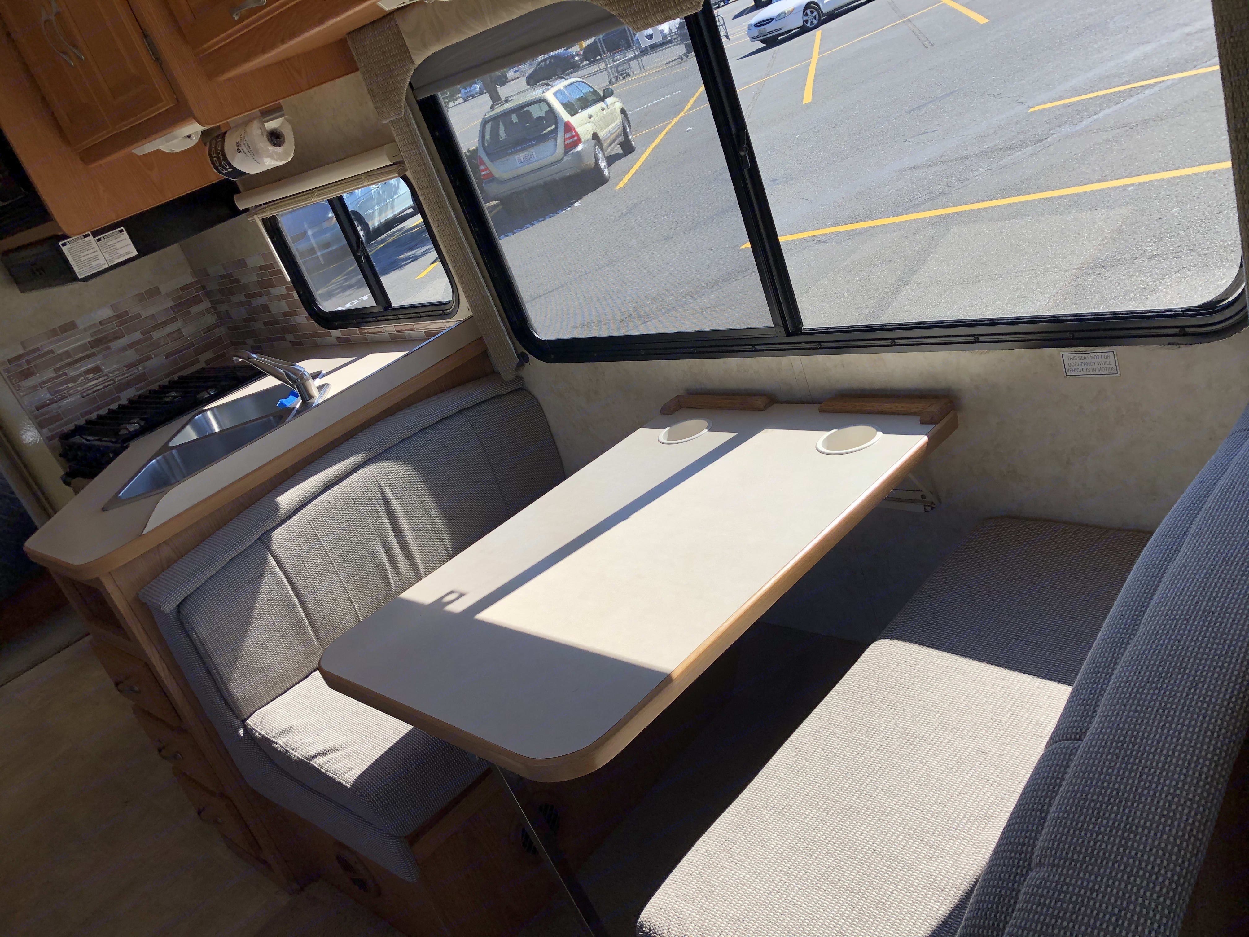 Banquet Table with 2 seatbelts on left bench. Chevrolet 28AFourWindFive-Thousand 2005