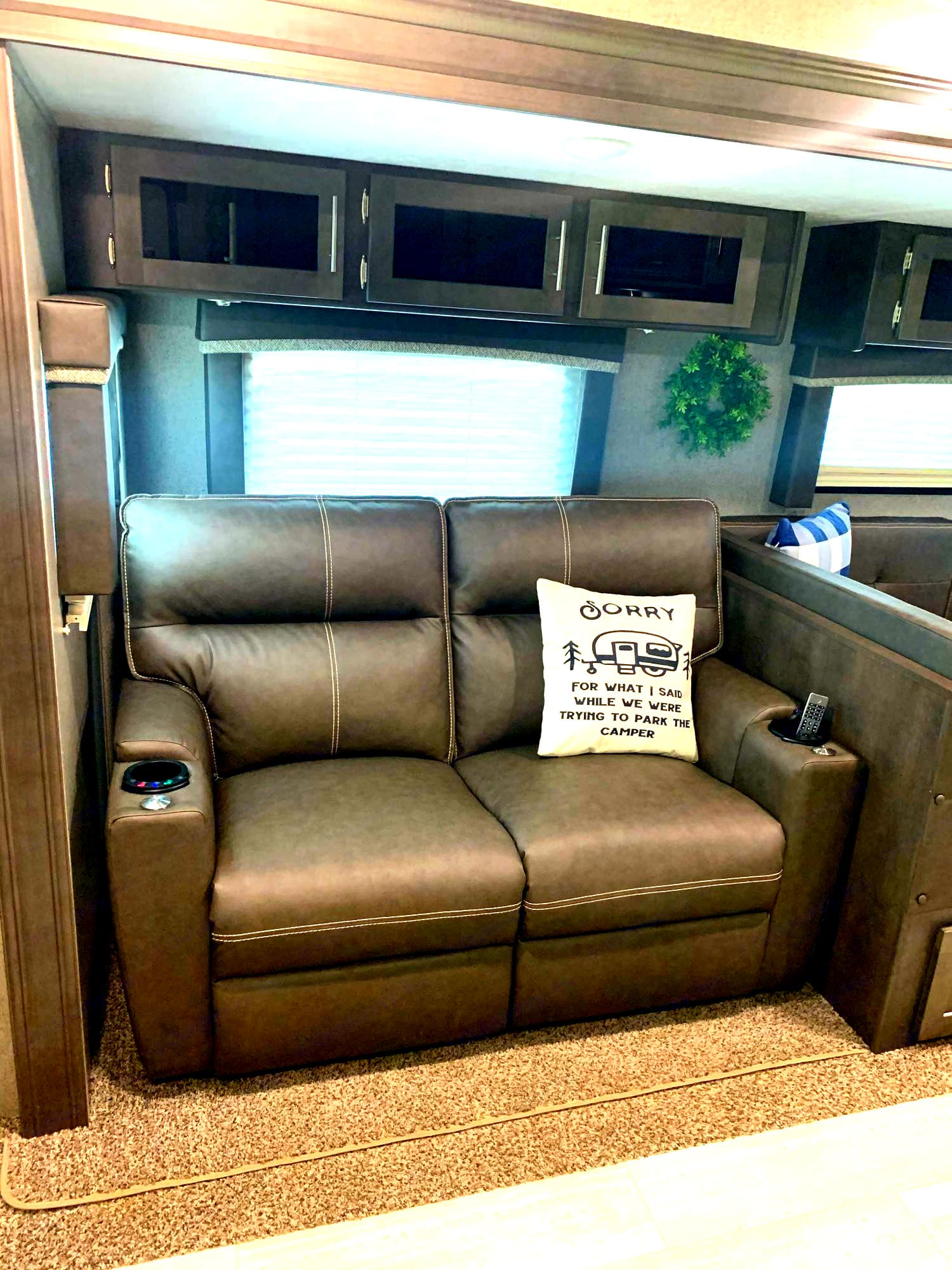 Theater seating: 2 recliners, massage, heat, cup holders, removable tables, and lights; faces TV.. Forest River Rockwood Ultra Lite 2020