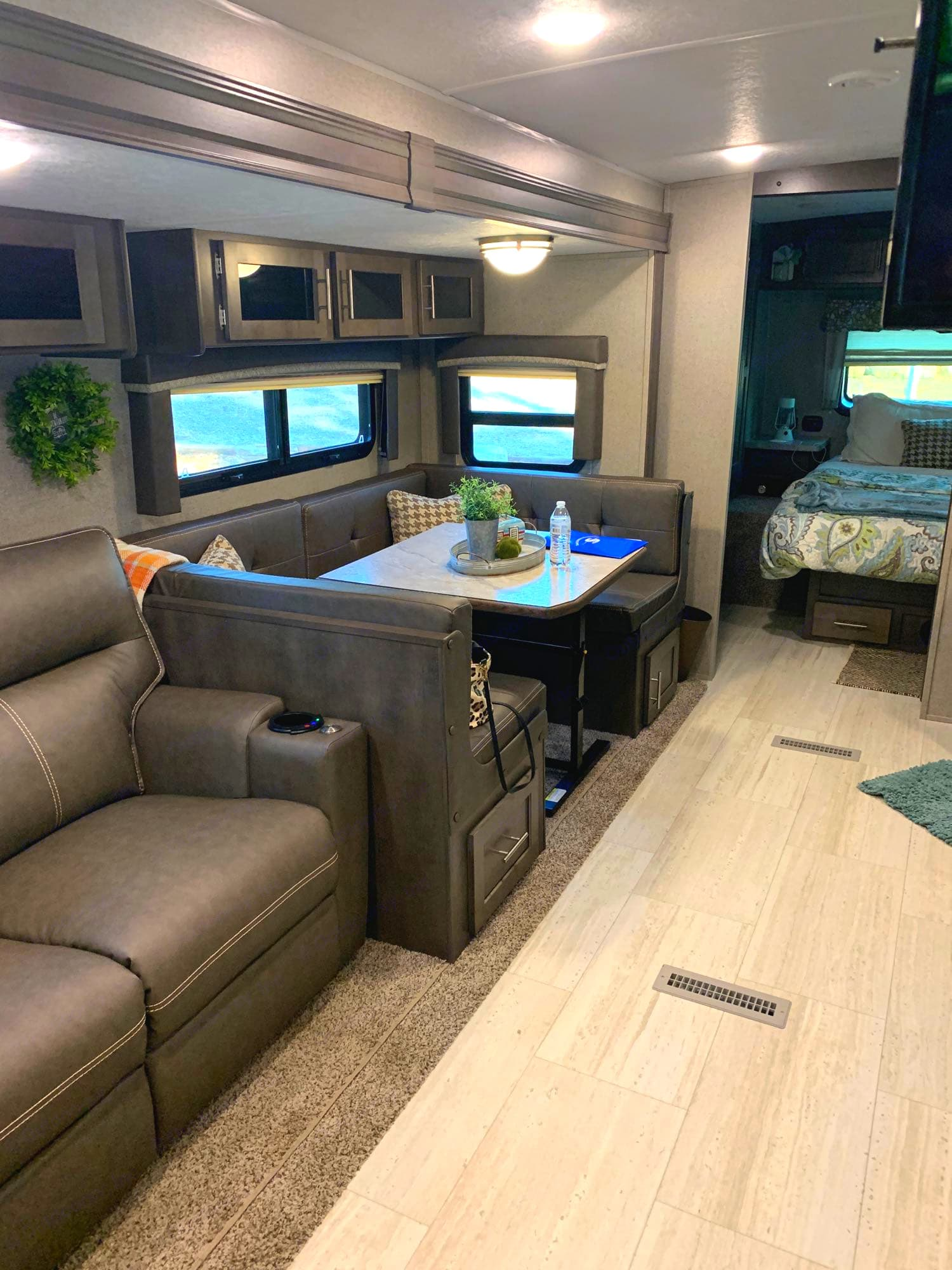 King size U-shaped dinette easily converts into full sized bed or fits 6 people around for game night.. Forest River Rockwood Ultra Lite 2020