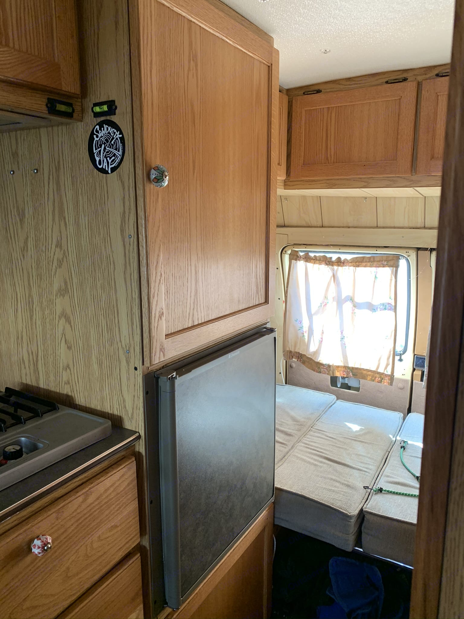Fridge and back area turns into a small bed and can also be set up at as sitting area with table.. Dodge Dodge Bighorn 3500 Heavy Duty 1985