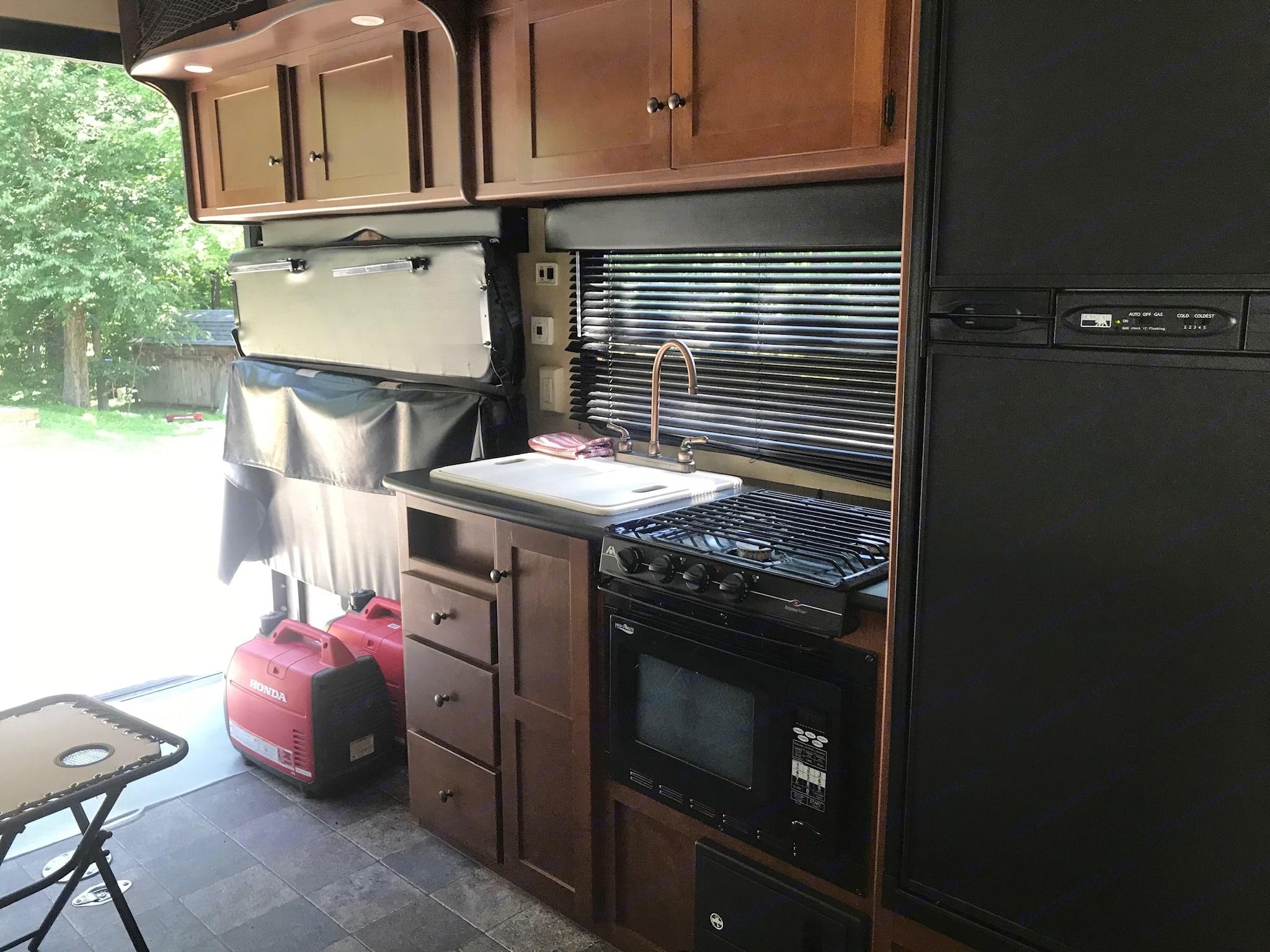 Kitchen: microwave, stove, sink. Dutchman Rubicon 2012