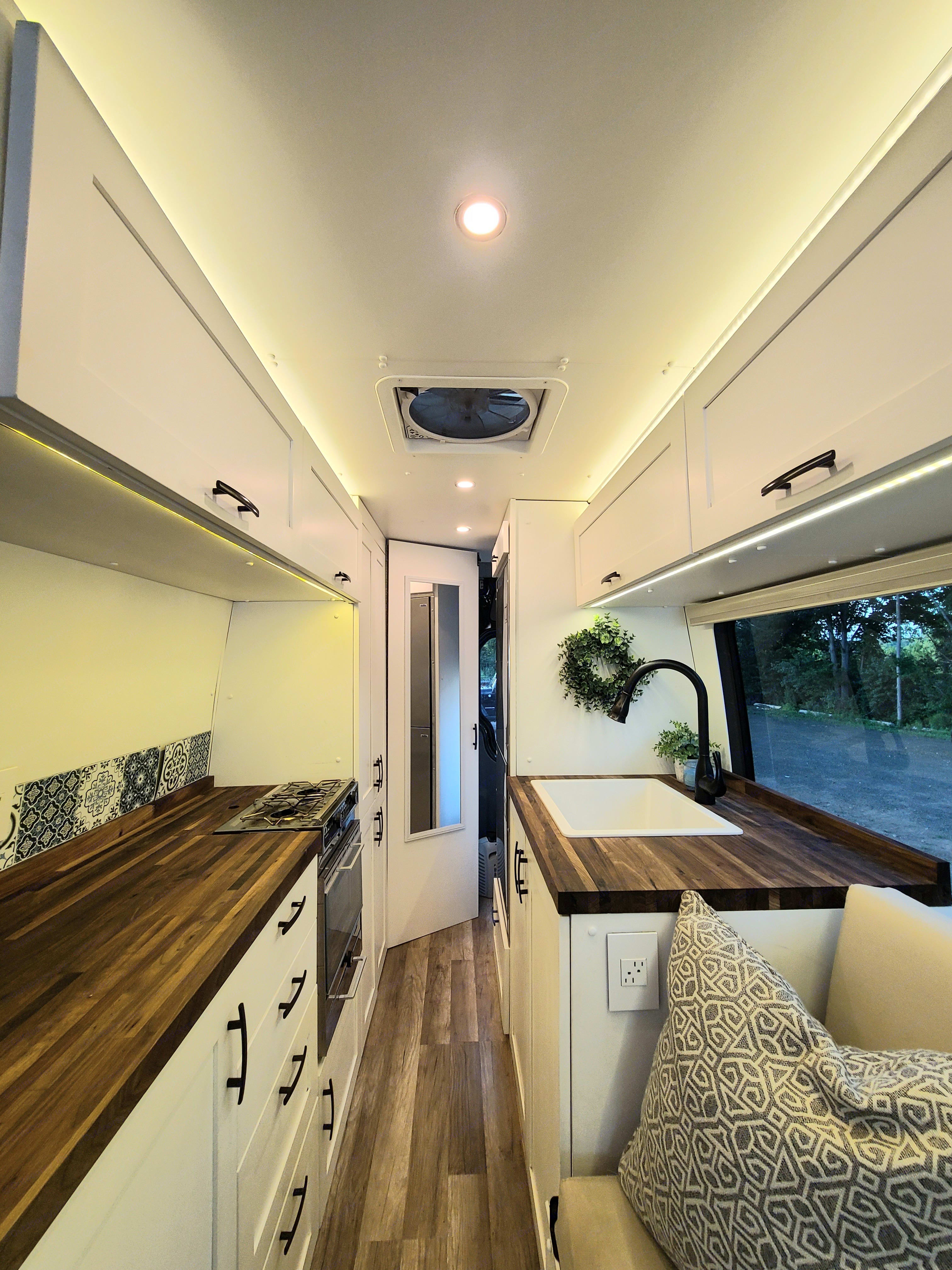 Plenty of lighting options including under cabinets, LED recessed trim lights down hall with dimmer and in back bath/storage area lighting. Mercedes Sprinter 2014
