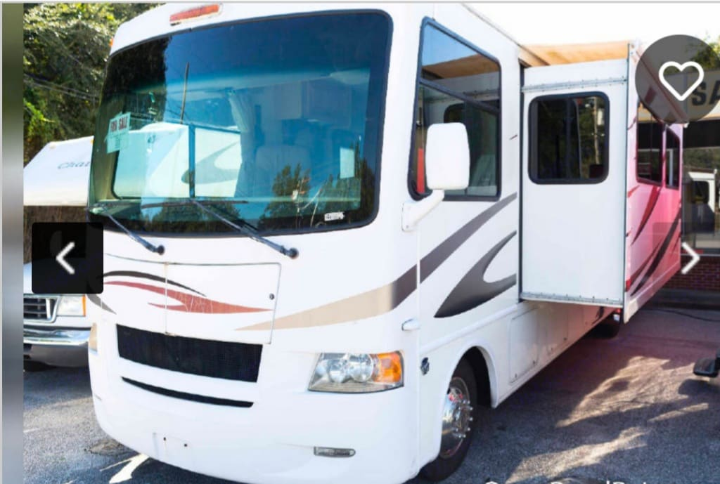 RV with 2 slide out rooms. Thor Motor Coach Four Winds 2011