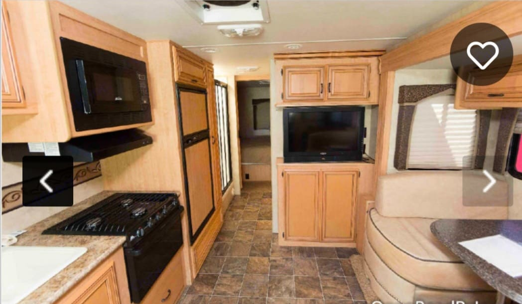 Dinette and kitchen. Thor Motor Coach Four Winds 2011
