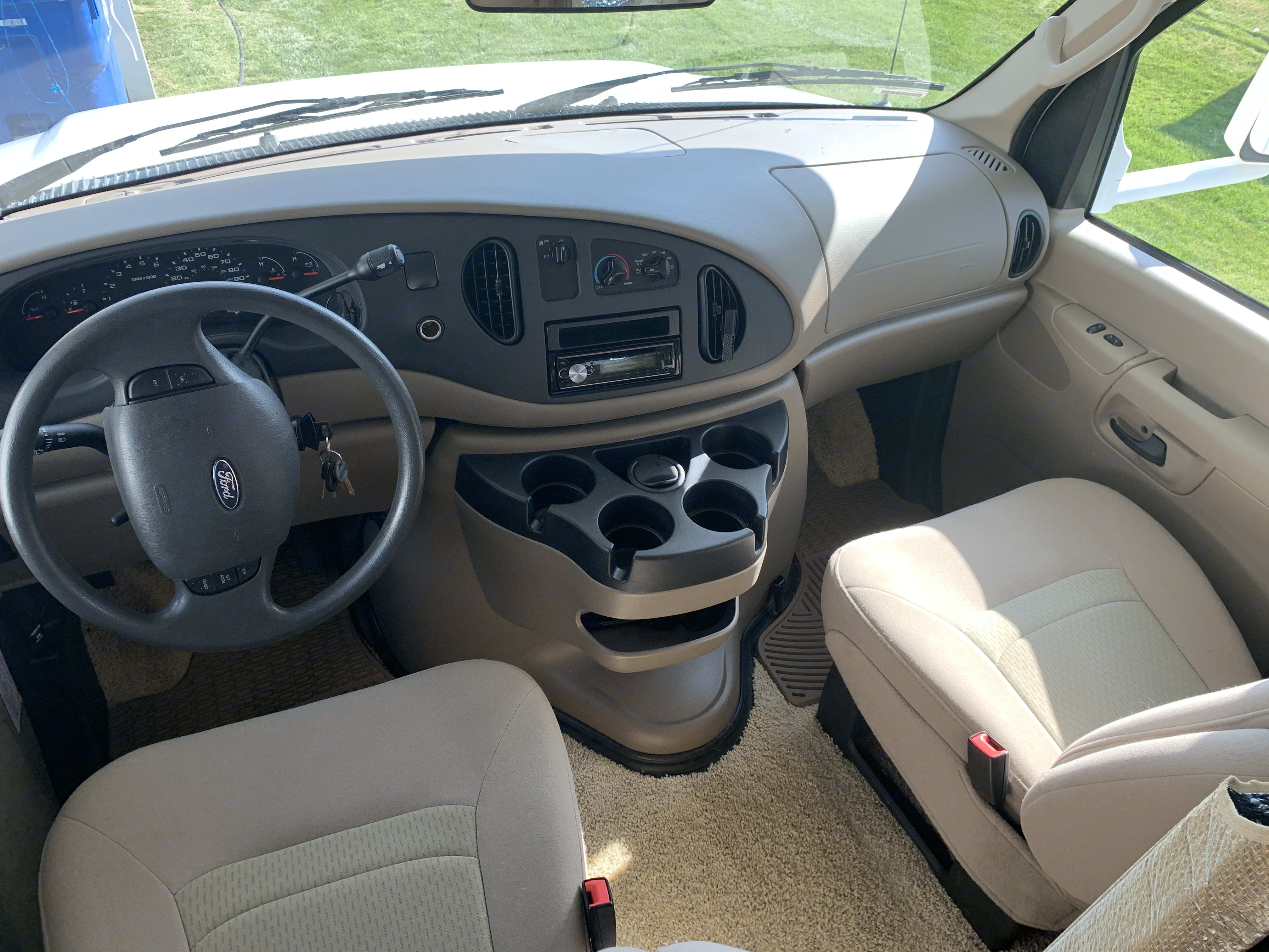 Spacious cab with fully reclining passenger seat and Bluetooth connected stereo. Winnebago Access 2008