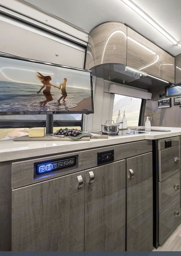 TV in the living/kitchen area and another. tv in the bedroom. Winnebago Era 2020