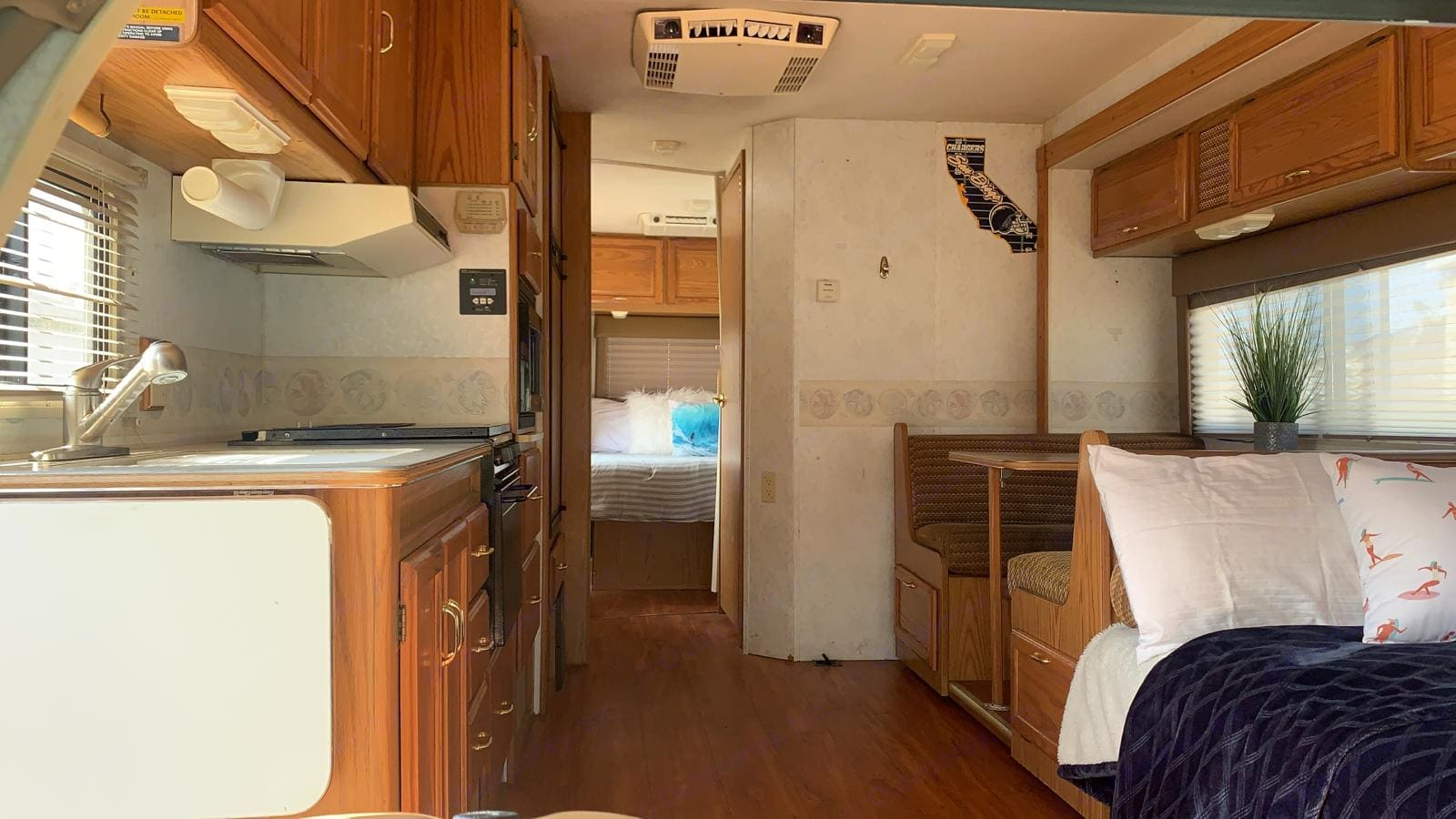 Sofa bed sleeps 2 + dinette converts to bed and sleeps 2 (this entire section slides out). Private rear bedroom w/ queen bed sleeps 2.. Winnebago Minnie Winnie 1999