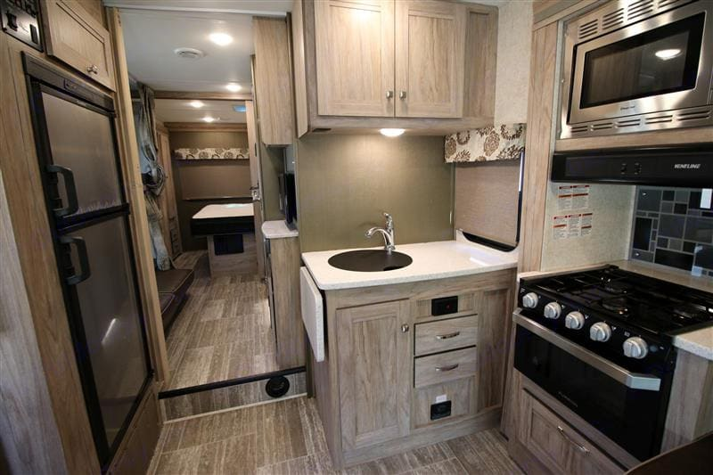 Full Service Kitchen with Refrigerator / Freezer, stove, oven, microwave, sink and LOTS of storage. Forest River Forester 2020