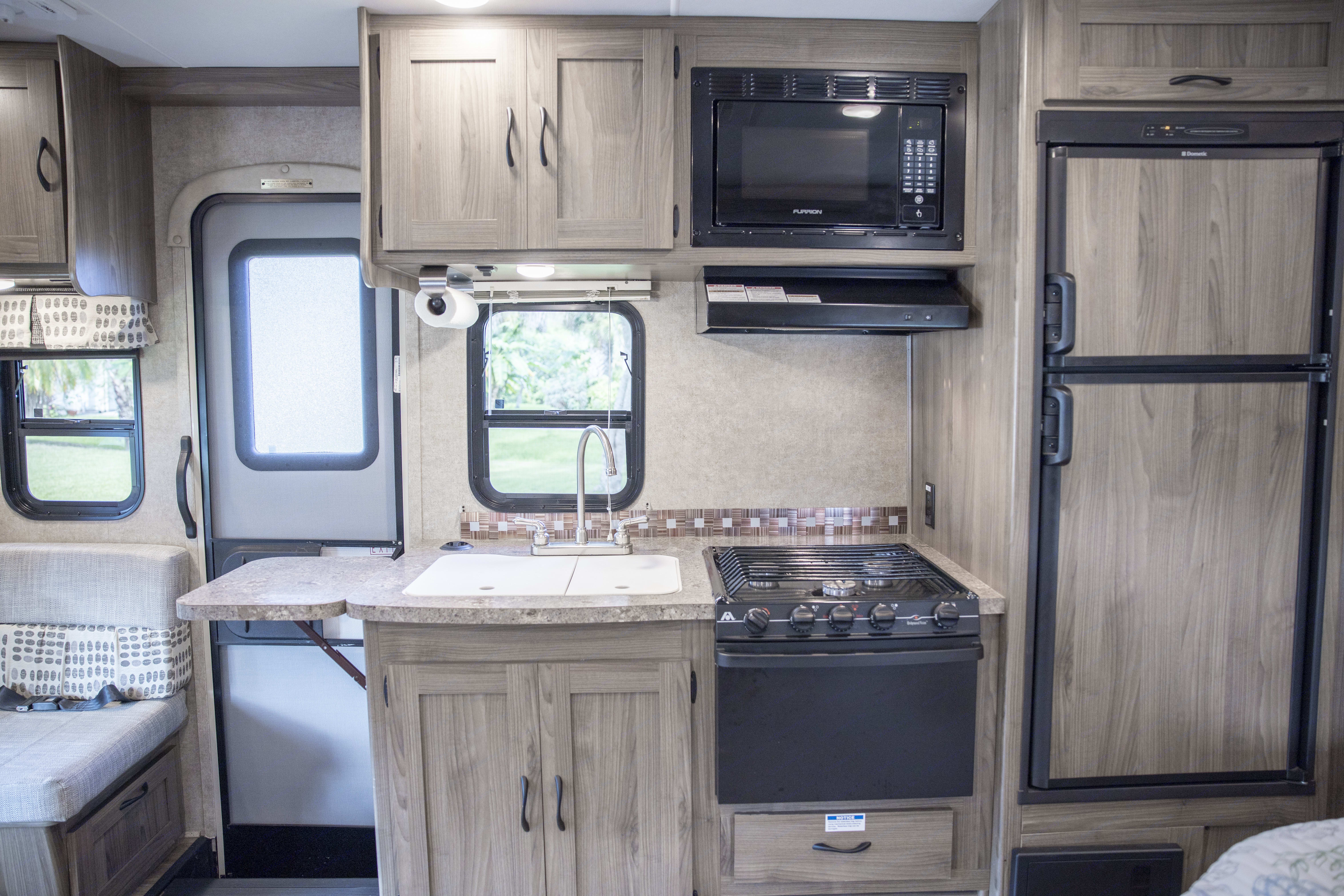 Kitchen with stove, oven microwave, very large sink, fridge and freezer.. Coachmen Prism 2016