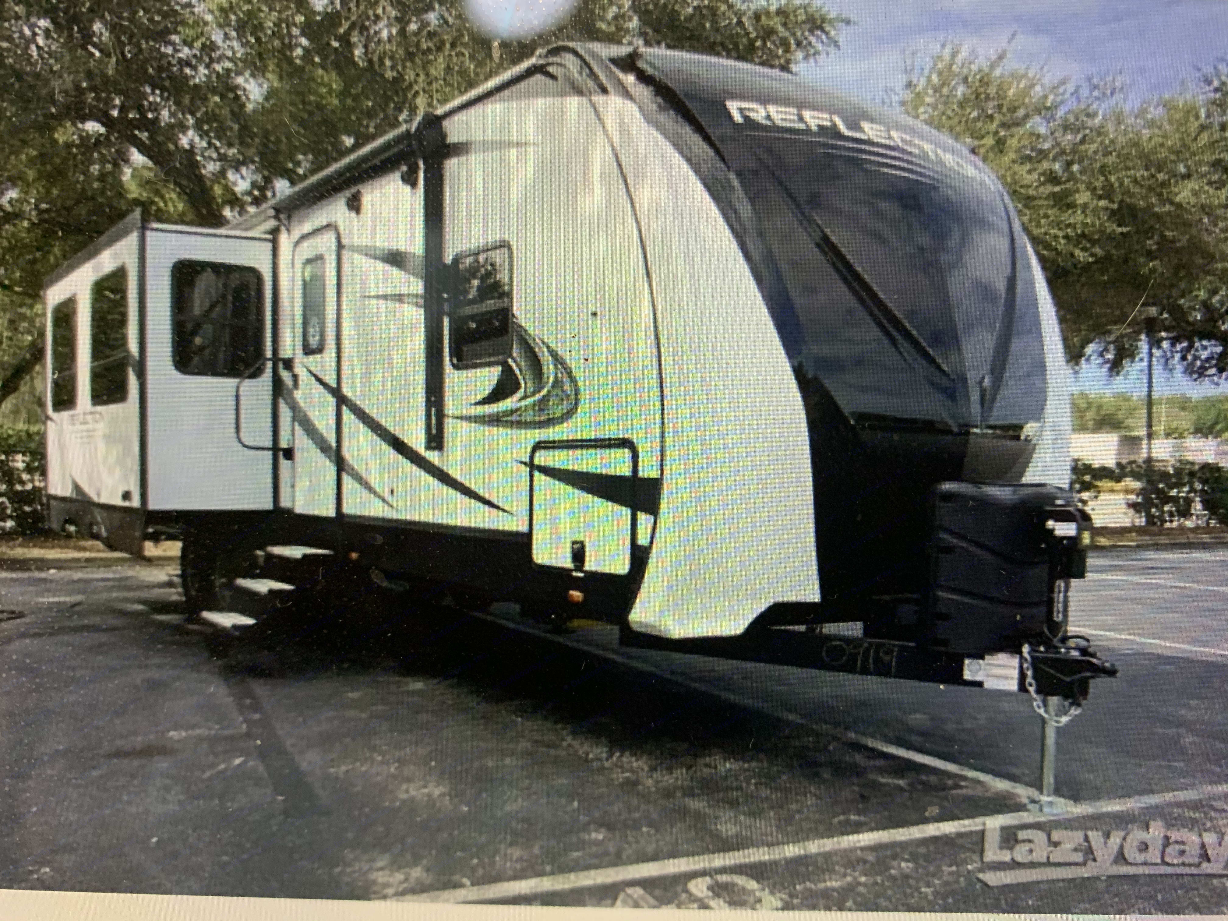 Outside of Travel Trailer with 3 slide outs. Grand Design Reflection 2021