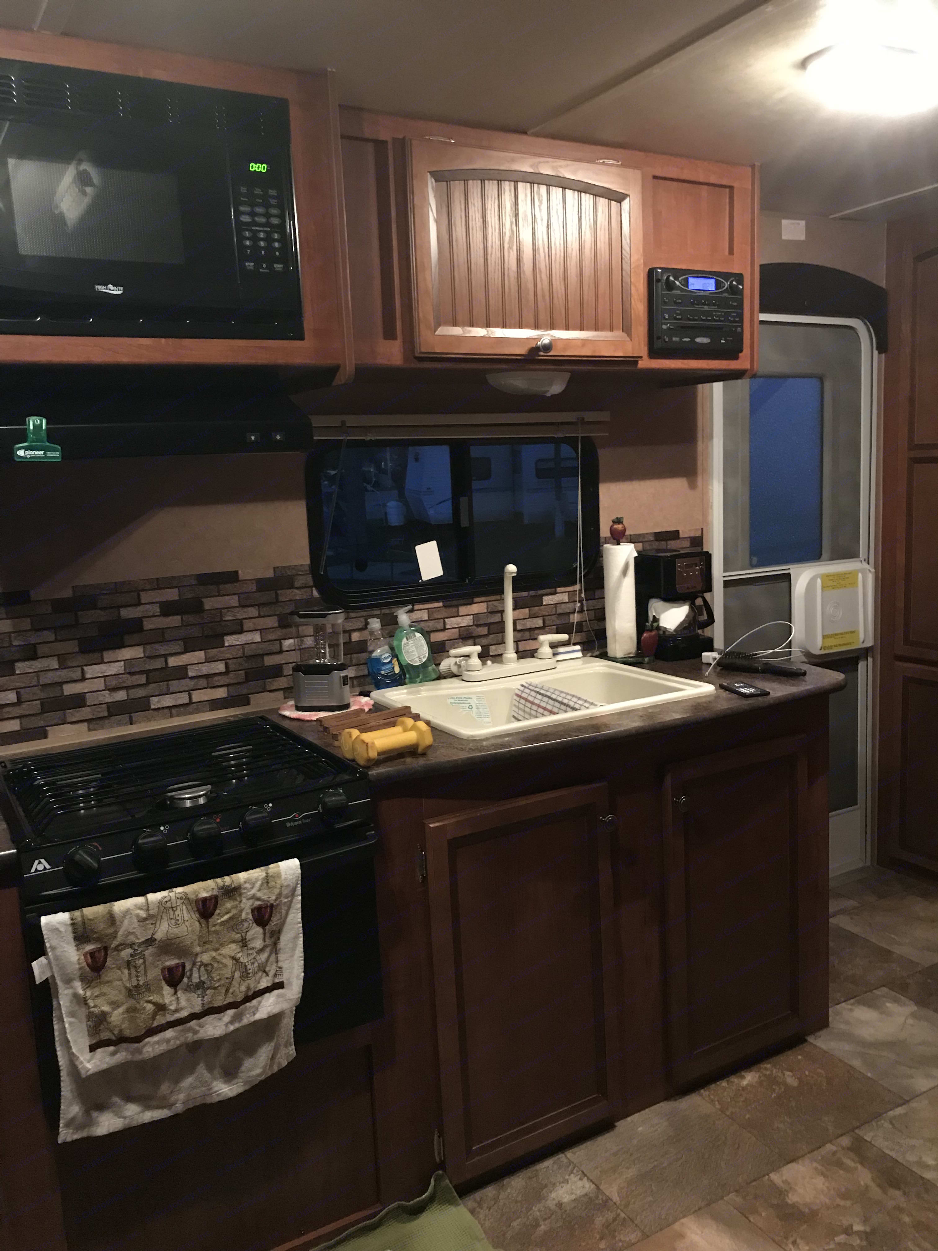galley kitchen with oven and microwave. Jayco Jay Feather Ultra Lite 2013